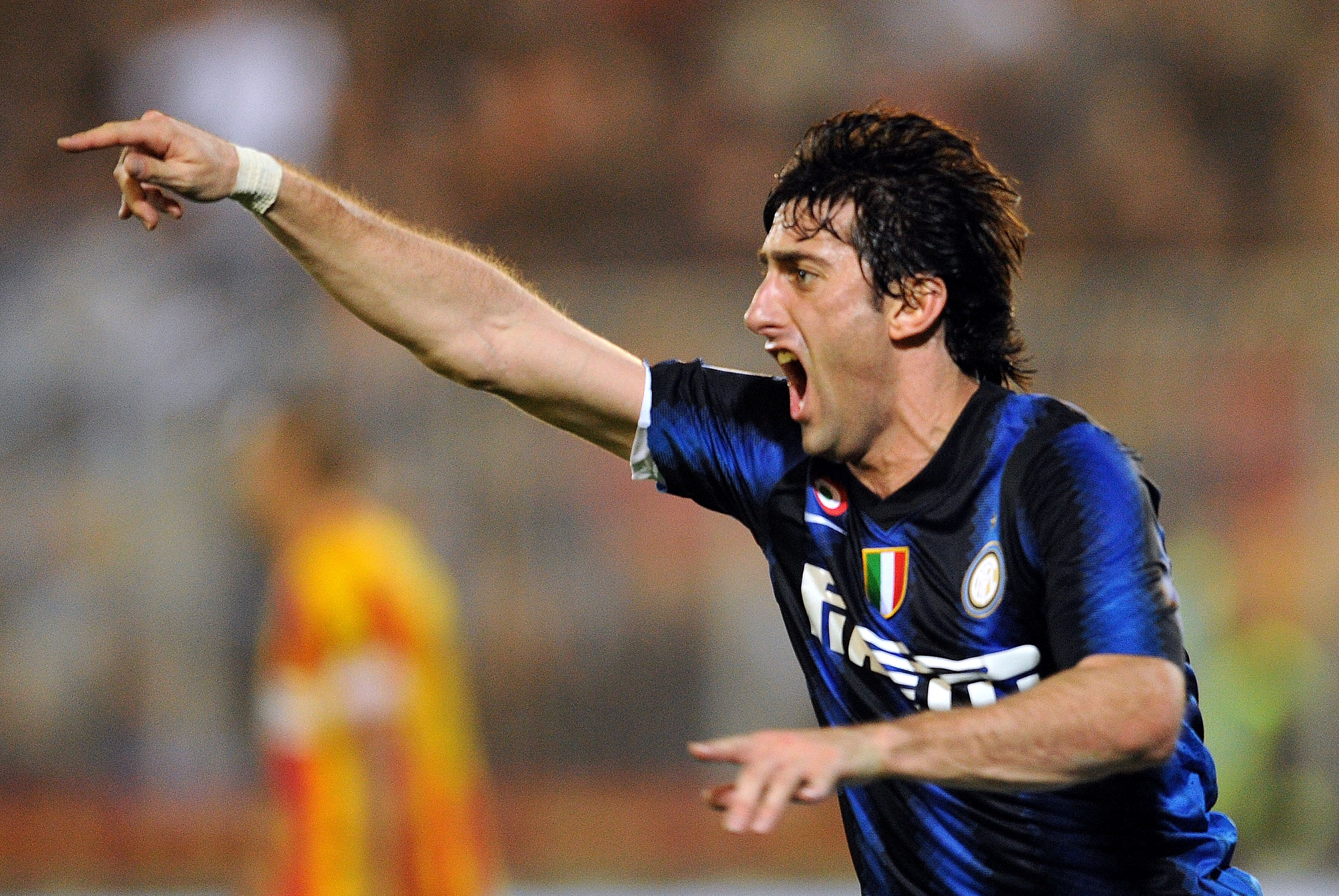 LECCE, ITALY - NOVEMBER 10:  Diego Milito of Inter celebrates after scoring the opening goal during the Serie A match between Lecce and Inter Milan at Stadio Via del Mare on November 10, 2010 in Lecce, Italy.  (Photo by Giuseppe Bellini/Getty Images)