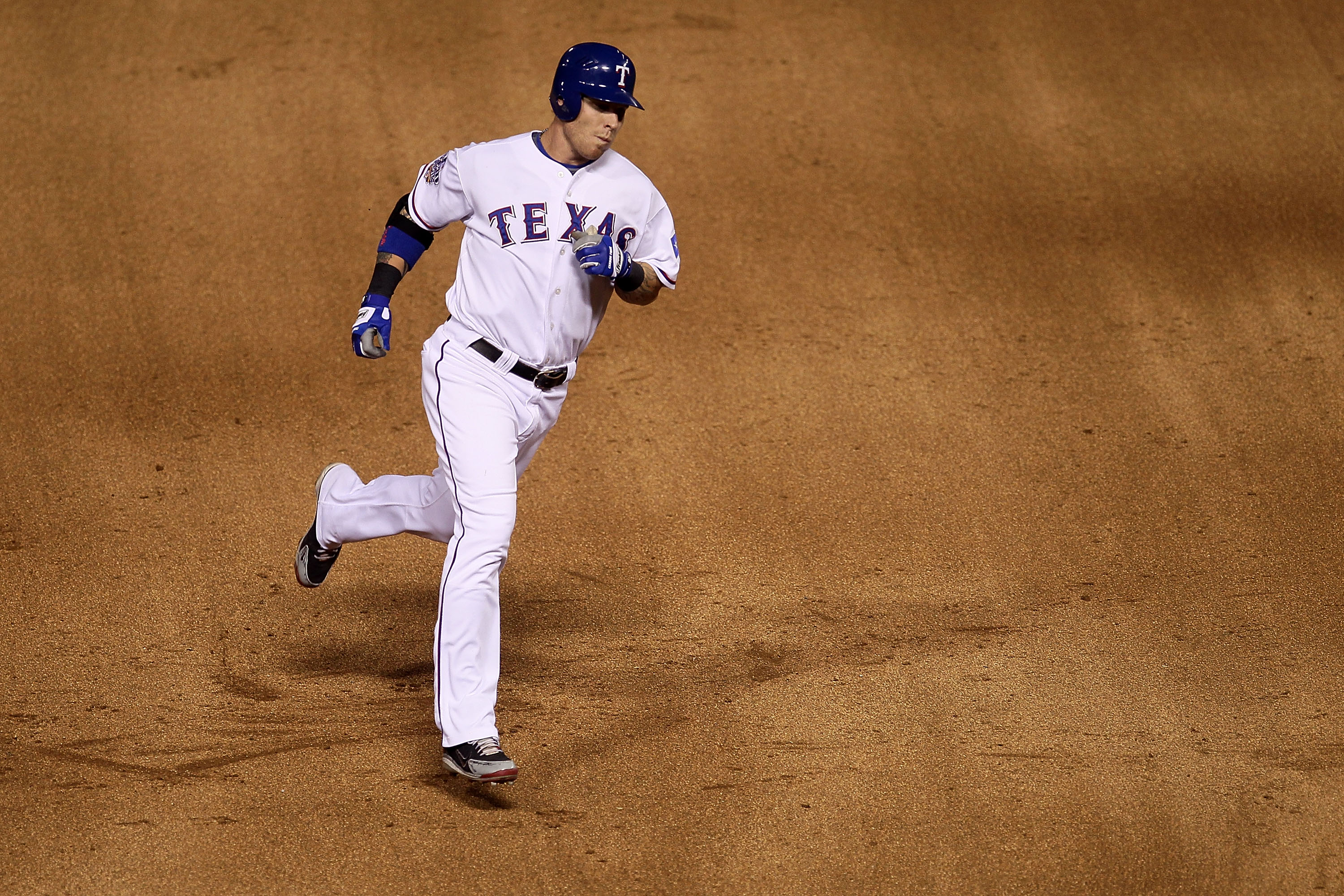 ARLINGTON, TX - OCTOBER 30:  Josh Hamilton #32 of the Texas Rangers rounds third base on his solo home run in the bottom of the fifth inning against the San Francisco Giants in Game Three of the 2010 MLB World Series at Rangers Ballpark in Arlington on Oc