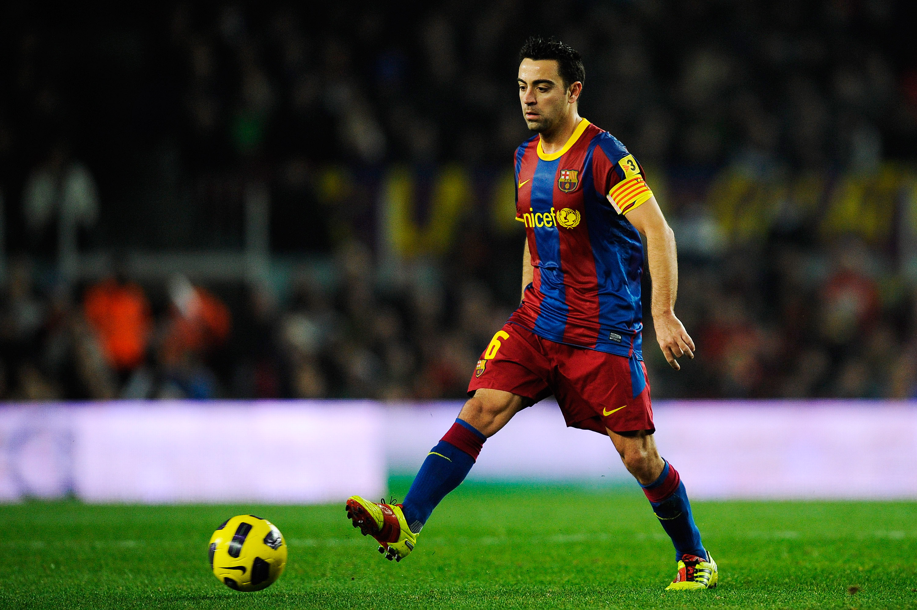 BARCELONA, SPAIN - JANUARY 02:  Xavi Hernandez of Barcelona passes the ball during the La Liga match between Barcelona and Levante UD at Camp Nou on January 2, 2011 in Barcelona, Spain. Barcelona won 2-1. Xavi Hernandez is set to make Barcelona history af