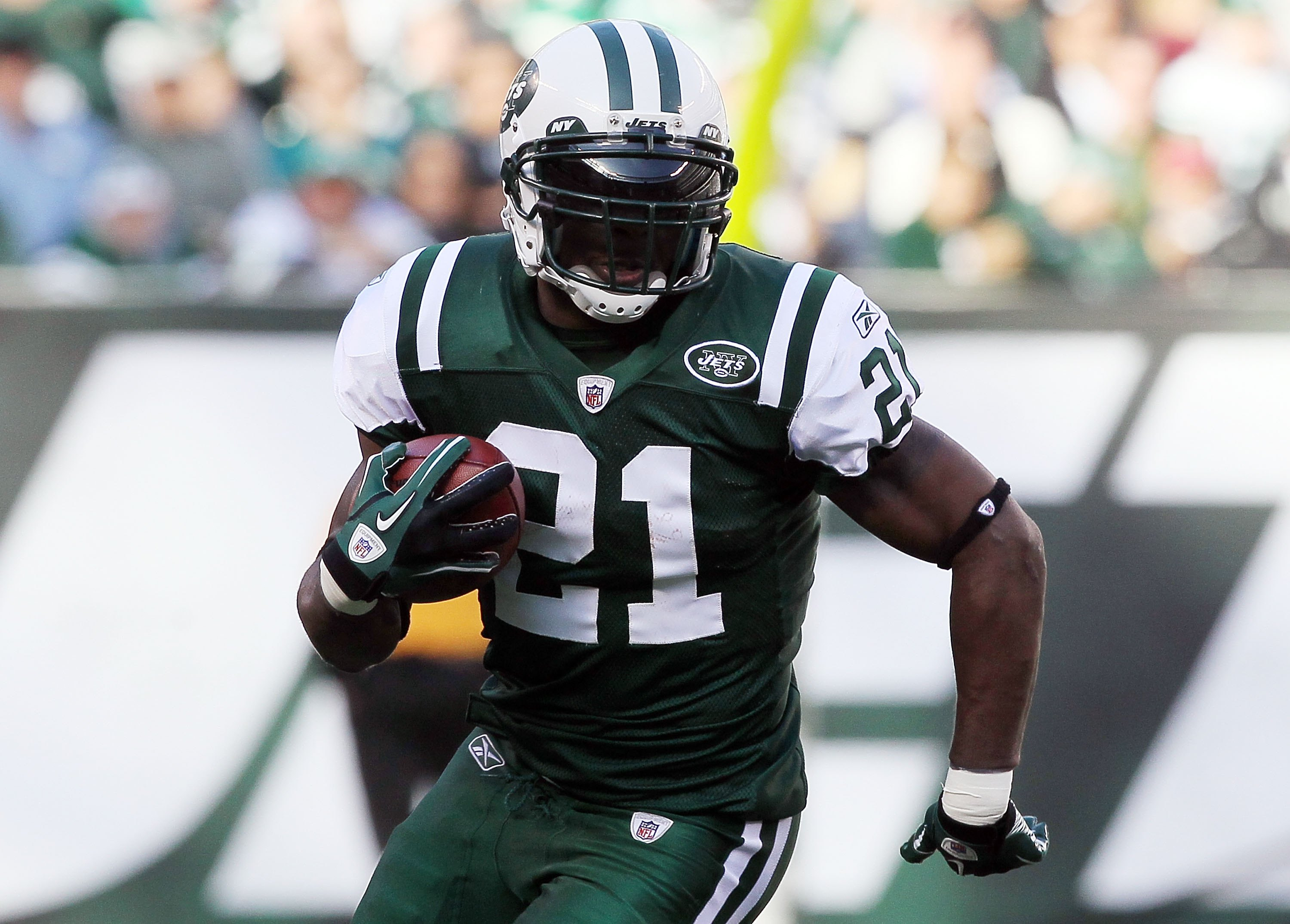 EAST RUTHERFORD, NJ - NOVEMBER 21:  LaDainian Tomlinson #21 of the New York Jets runs against the Houston Texans on November 21, 2010 at the New Meadowlands Stadium in East Rutherford, New Jersey.  (Photo by Jim McIsaac/Getty Images)