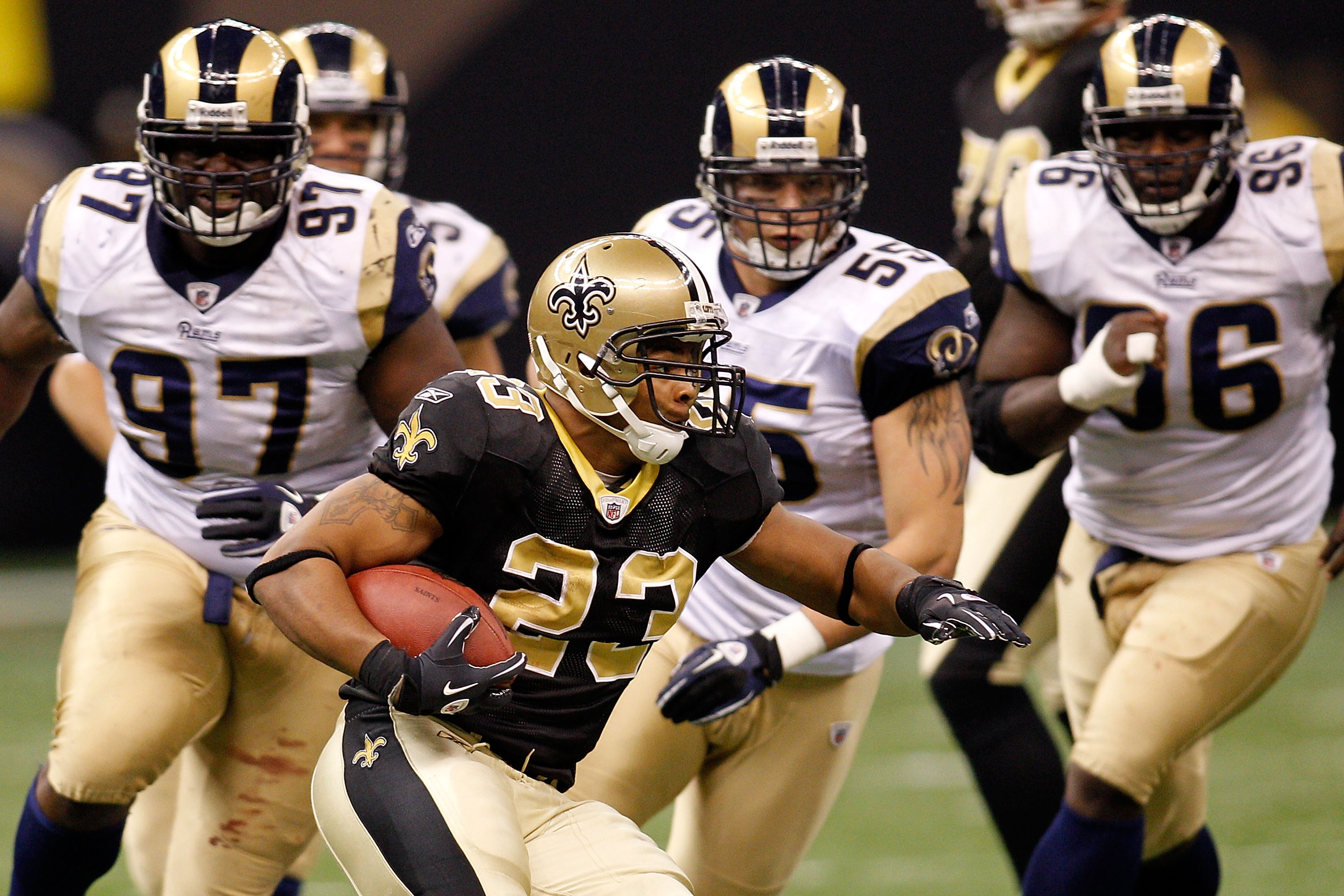 NEW ORLEANS, LA - DECEMBER 12:  Pierre Thomas #23 of the New Orleans Saints runs past the defense of the St. Louis Rams at the Louisiana Superdome on December 12, 2010 in New Orleans, Louisiana. The Saints defeated the Rams 31-13.  (Photo by Chris Graythe