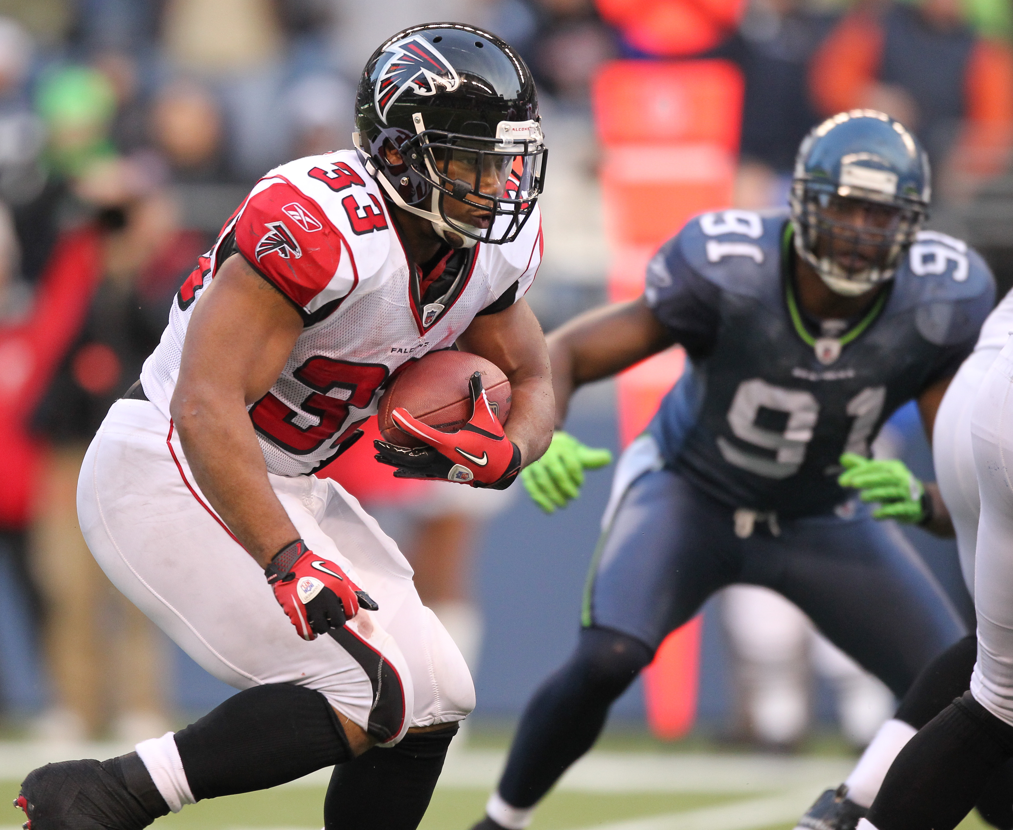 SEATTLE, WA - DECEMBER 19:  Running back Michael Turner #33 of the Atlanta Falcons rushes against the Seattle Seahawks at Qwest Field on December 19, 2010 in Seattle, Washington. (Photo by Otto Greule Jr/Getty Images)