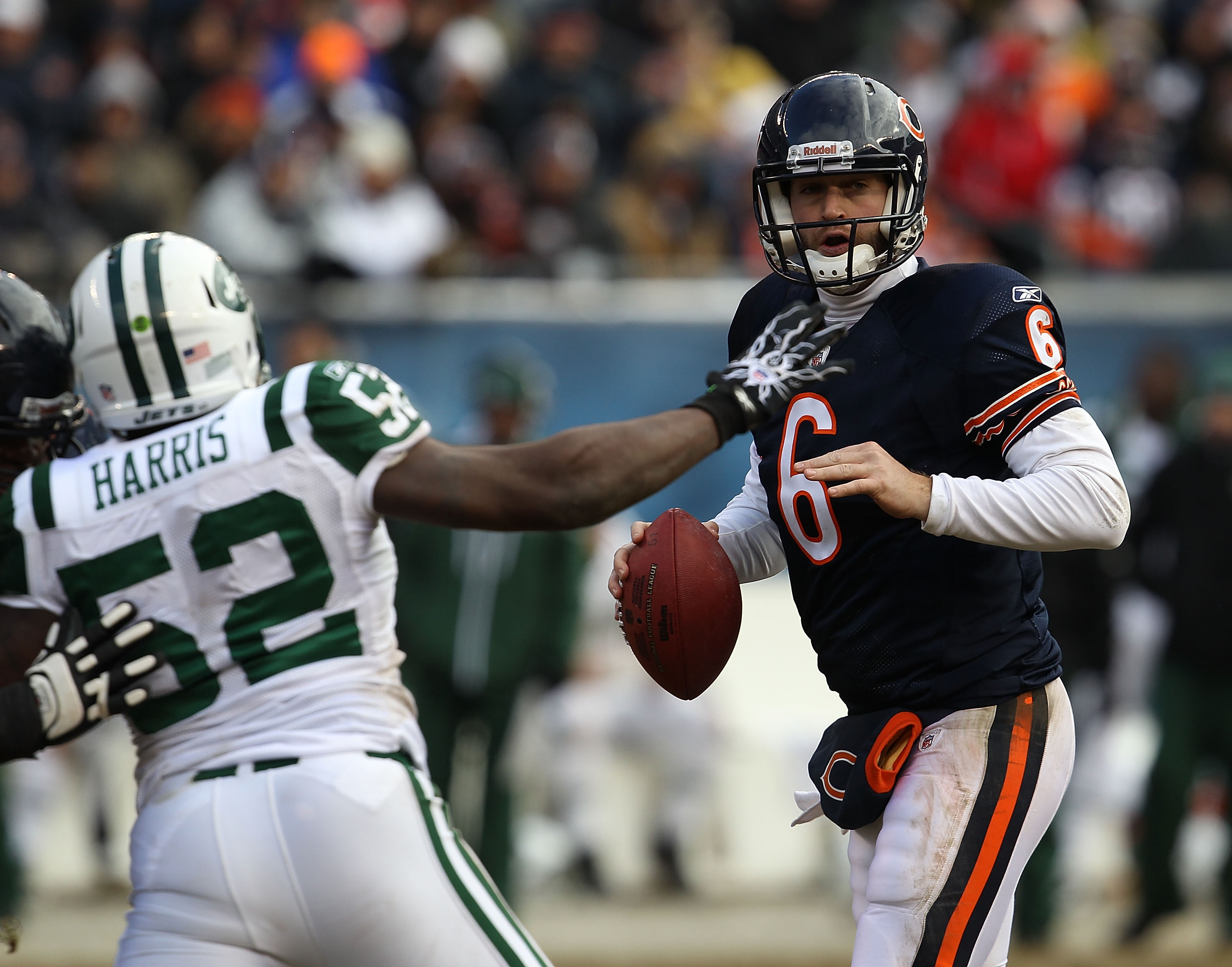 CHICAGO, IL - DECEMBER 26: Jay Cutler #6 of the Chicago Bears looks for a receiver as David Harris #52 of the New York Jets rushes at Soldier Field on December 26, 2010 in Chicago, Illinois. The Bears defeated the Jets 38-34. (Photo by Jonathan Daniel/Get