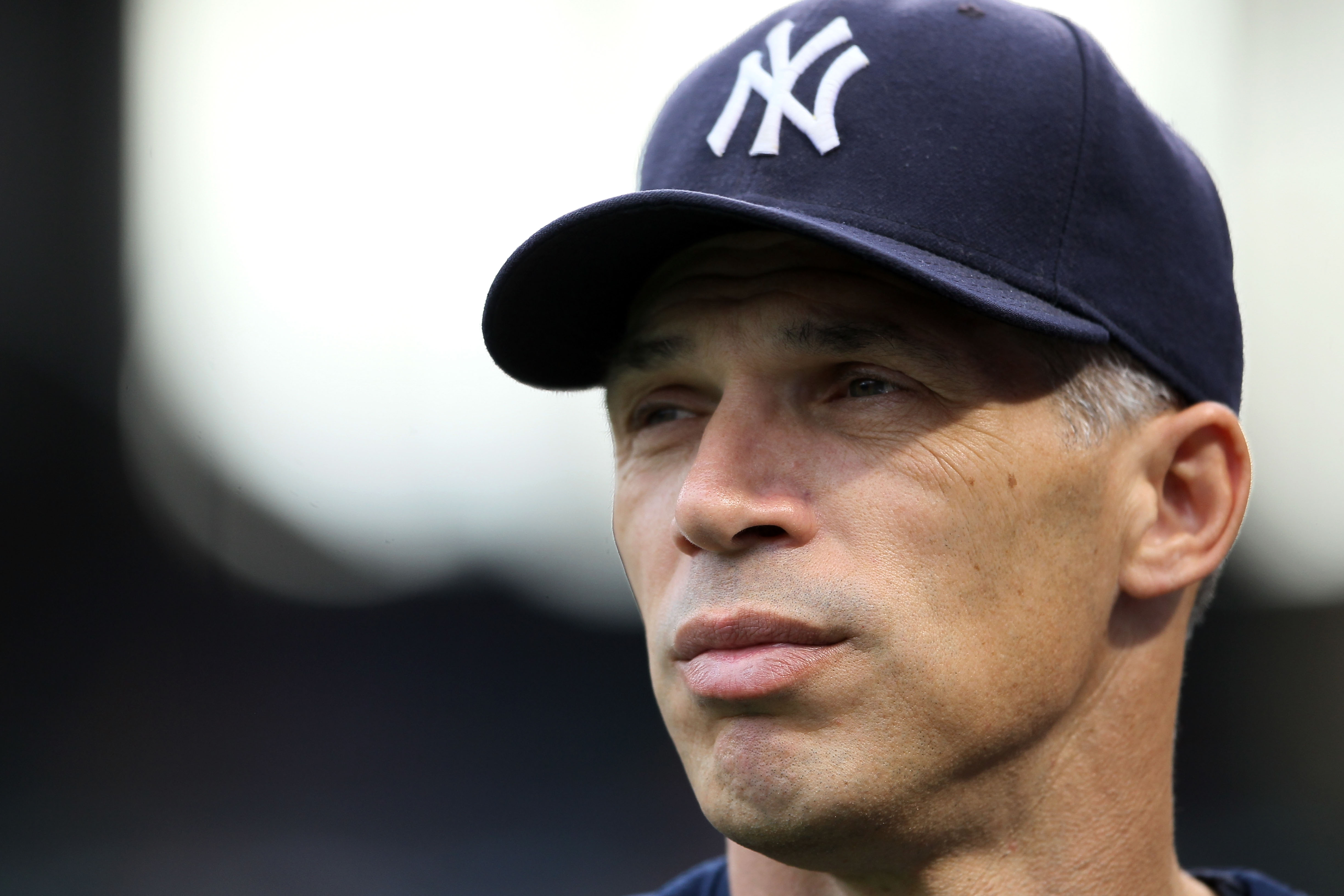 ARLINGTON, TX - OCTOBER 22:  Manager Joe Girardi of the New York Yankees looks on during batting practice prior to Game Six of the ALCS against the Texas Rangers during the 2010 MLB Playoffs at Rangers Ballpark in Arlington on October 22, 2010 in Arlingto