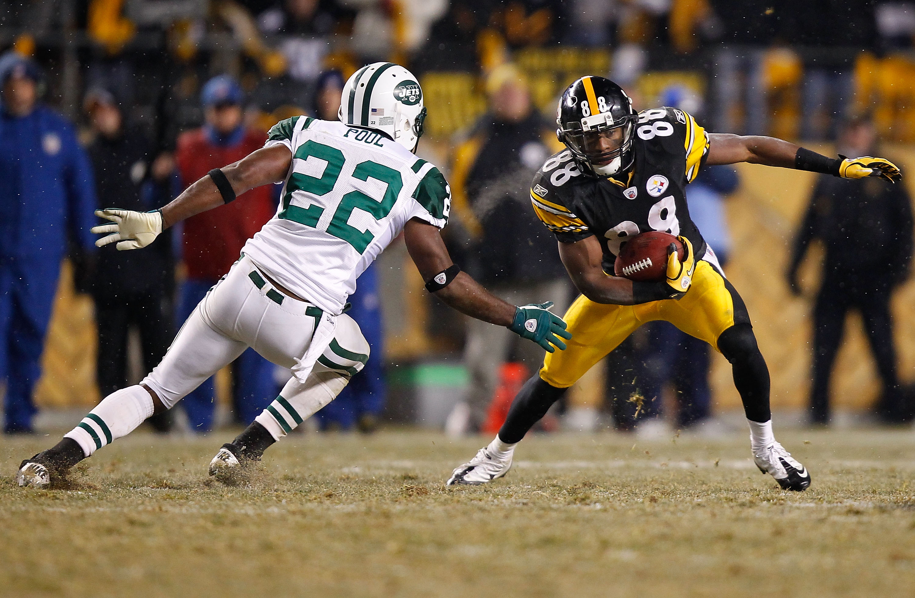PITTSBURGH - DECEMBER 19:  Emmanuel Sanders #88 of the Pittsburgh Steelers evades a tackle by Brodney Pool #22 of the New York Jets during the game on December 19, 2010 at Heinz Field in Pittsburgh, Pennsylvania.  (Photo by Jared Wickerham/Getty Images)
