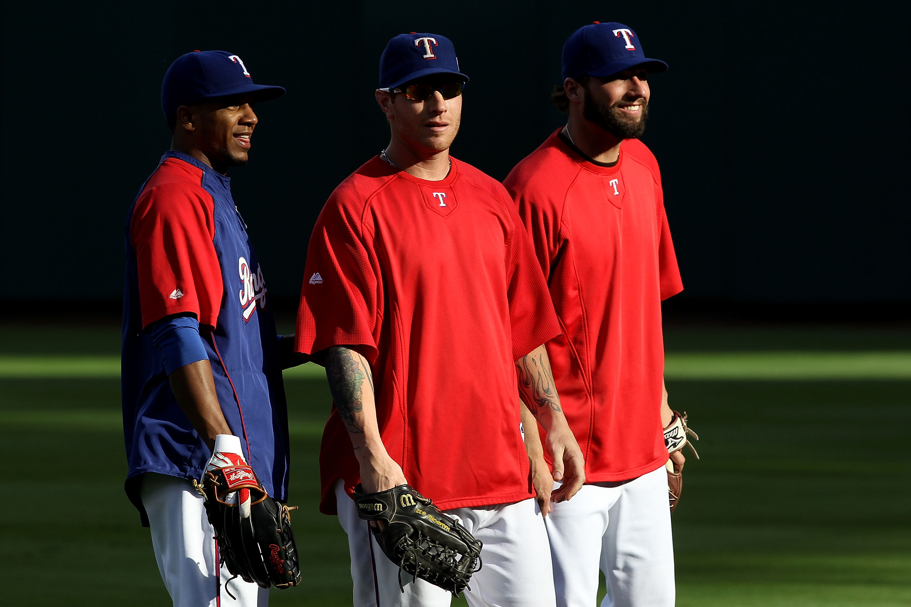 ARLINGTON, TX - OCTOBER 31:  (L-R) Julio Borbon #29, Josh Hamilton #32 and Jeff Francoeur #21 of the Texas Rangers look on during batting practice against the San Francisco Giants in Game Four of the 2010 MLB World Series at Rangers Ballpark in Arlington