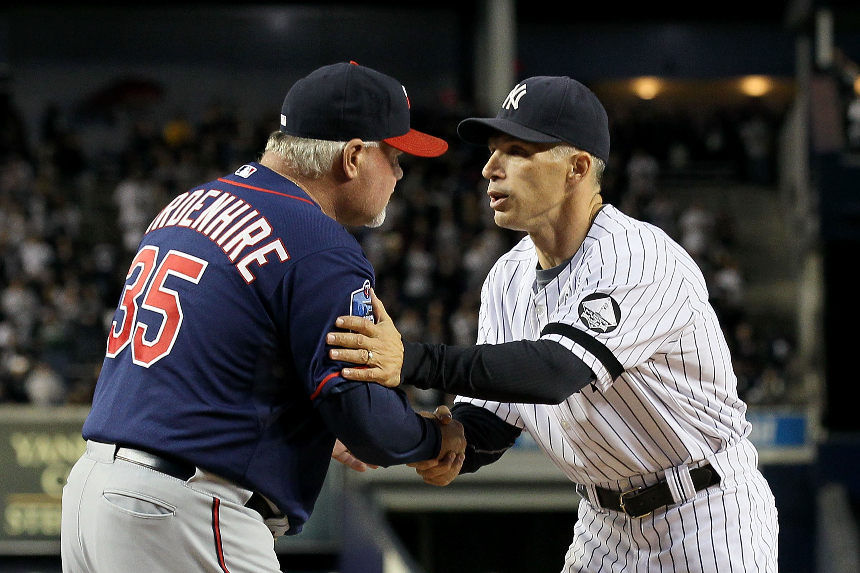 NEW YORK - OCTOBER 09:  Manager Joe Girardi #28 (R) of the New York Yankees greets manager Ron Gardenhire #35 of the Minnesota Twins prior to Game Three of the ALDS part of the 2010 MLB Playoffs at Yankee Stadium on October 9, 2010 in the Bronx borough of