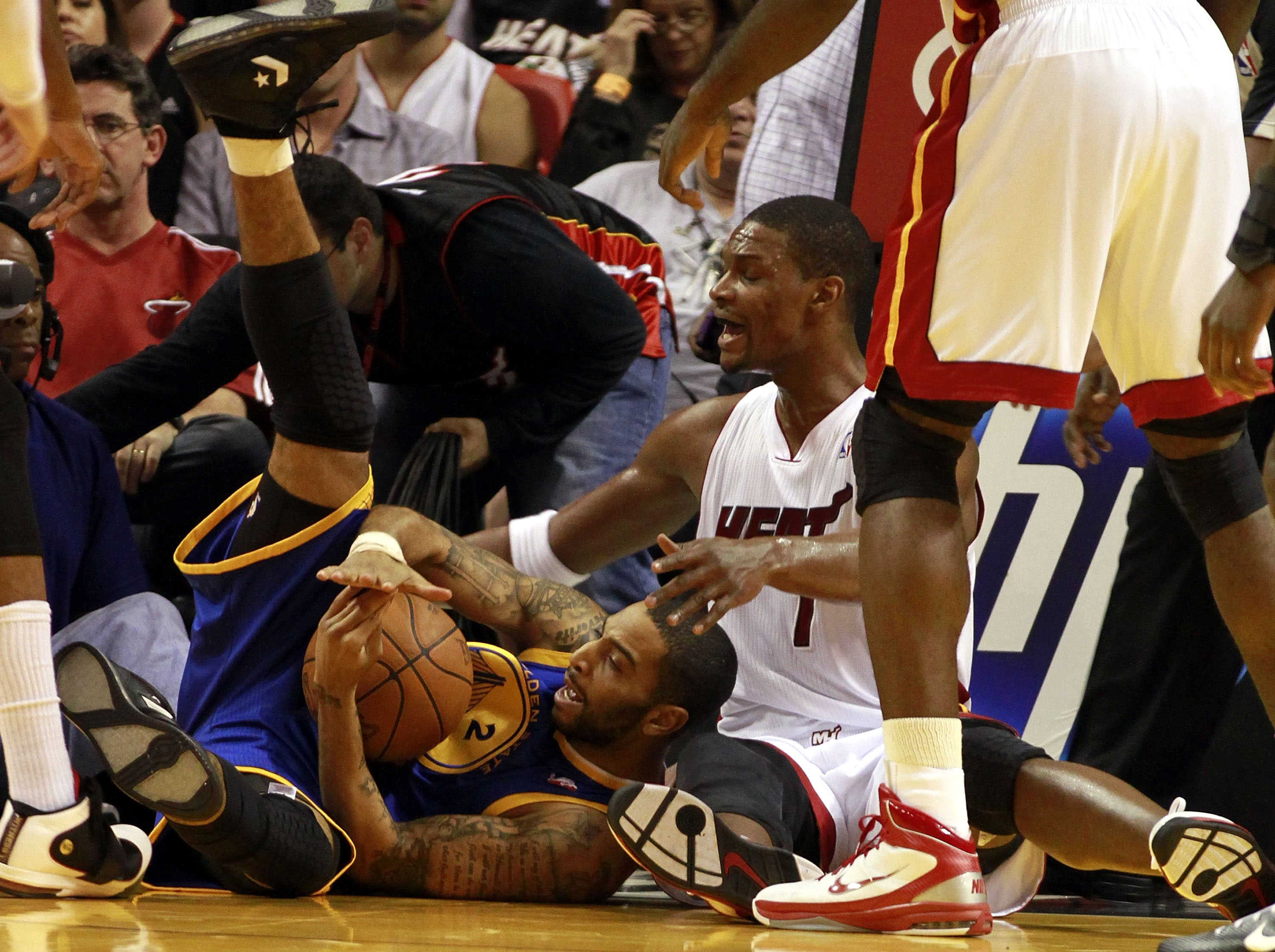 MIAMI, FL - JANUARY 01:  Forward Chris Bosh #1 of the Miami Heat rebounds against the Golden State Warriors at American Airlines Arena on January 1, 2011 in Miami, Florida.  NOTE TO USER: User expressly acknowledges and agrees that, by downloading and/or