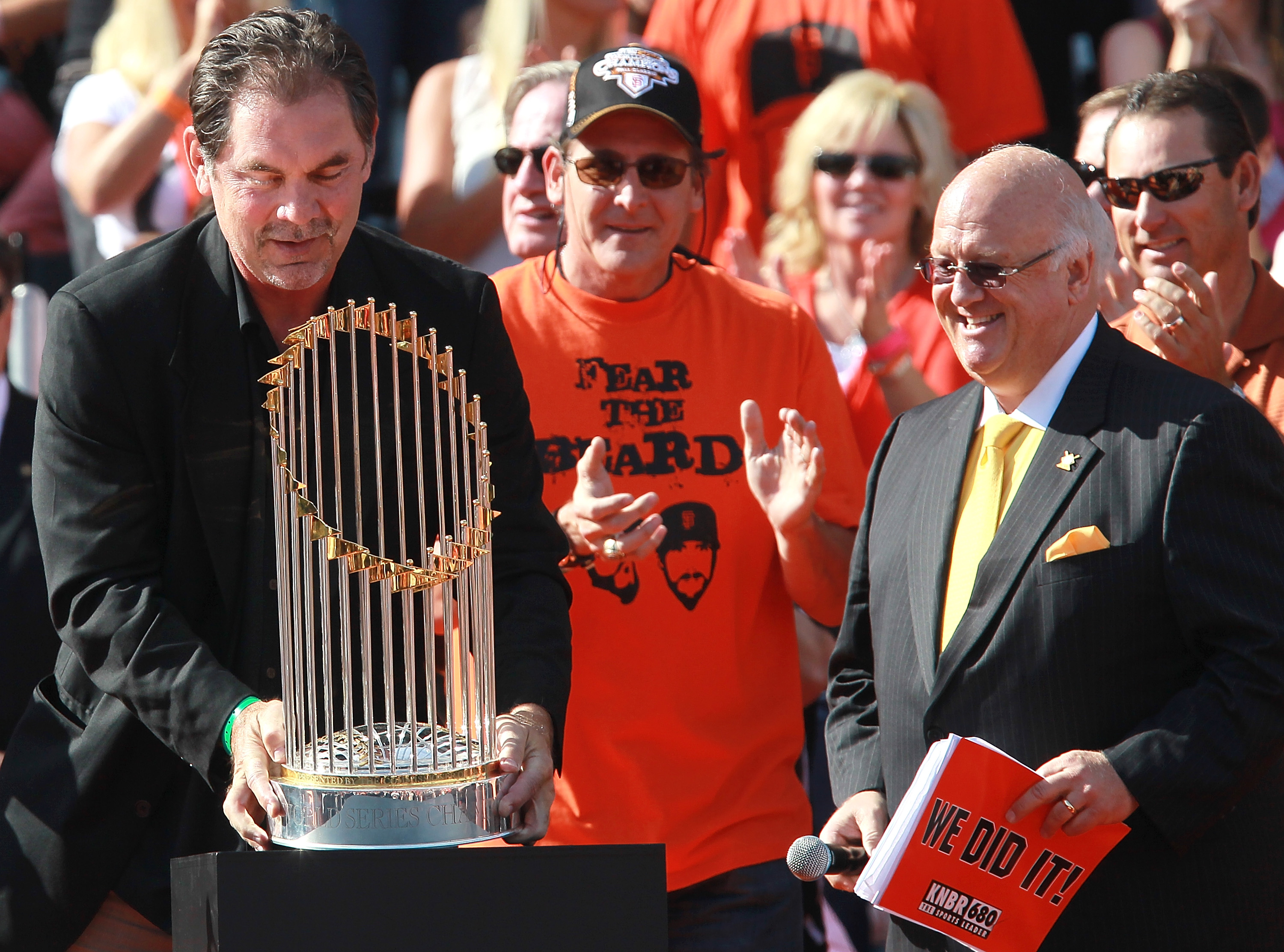 SAN FRANCISCO - NOVEMBER 03:  San Francisco Giants manager Bruce Bochy (L) carries the World Series trophy at the conclusion of the Giants' victory parade on November 3, 2010 in San Francisco, California. Thousands of Giants fans lined the streets of San