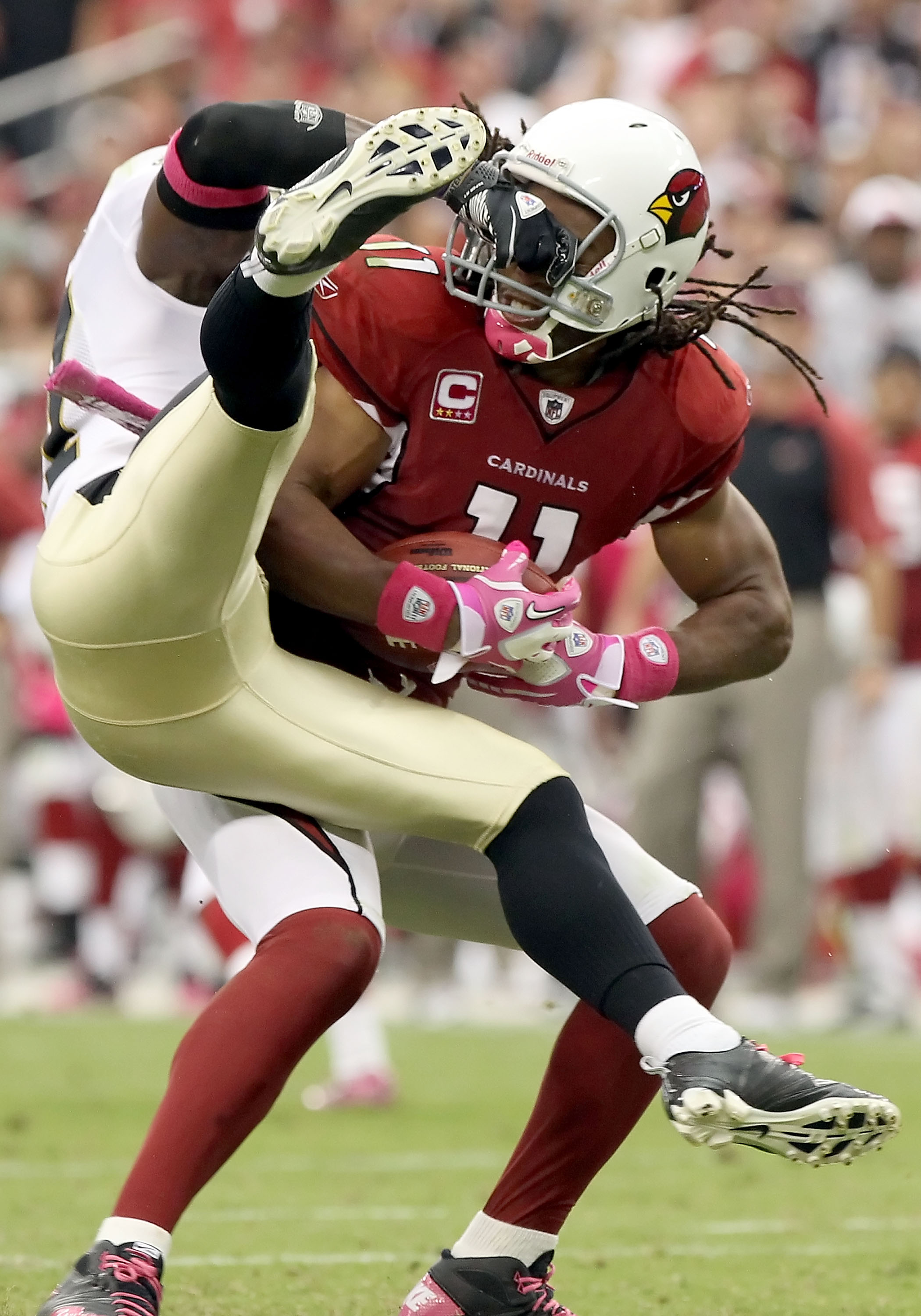 GLENDALE, AZ - OCTOBER 10:  Wide receiver Larry Fitzgerald #11 of the Arizona Cardinals gets facemasked by Malcolm Jenkins #27 of the New Orleans Saints after a 17 yard reception during the fourth quarter of the NFL game at the University of Phoenix Stadi