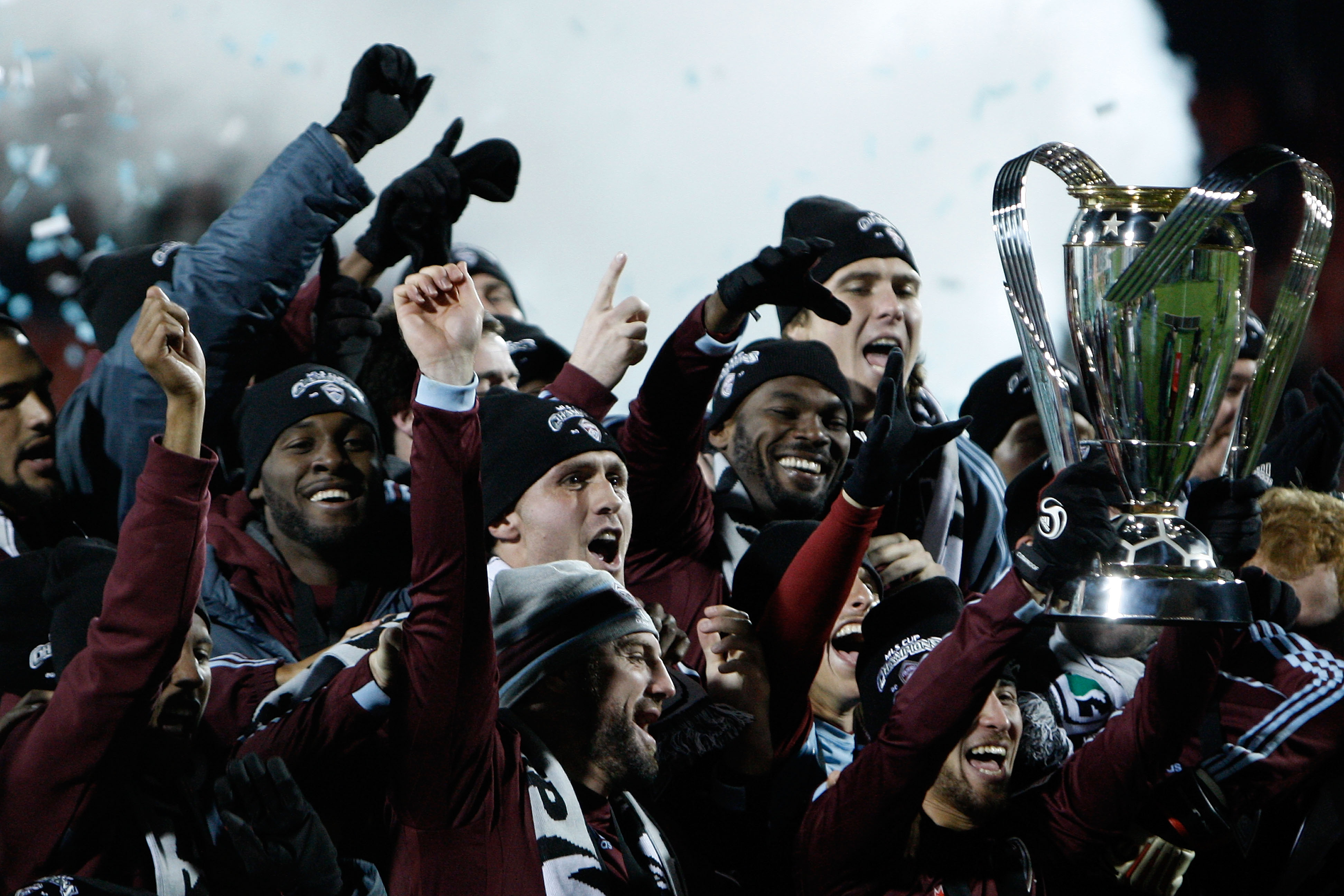 TORONTO, ON - NOVEMBER 21:  Kosuke Kimura #27 of the Colorado Rapids holds the Philip F. Anschutz Trophy and celebrates with teammates after their 2-1 overtime victory against FC Dallas during the 2010 MLS Cup match at BMO Field on November 21, 2010 in To