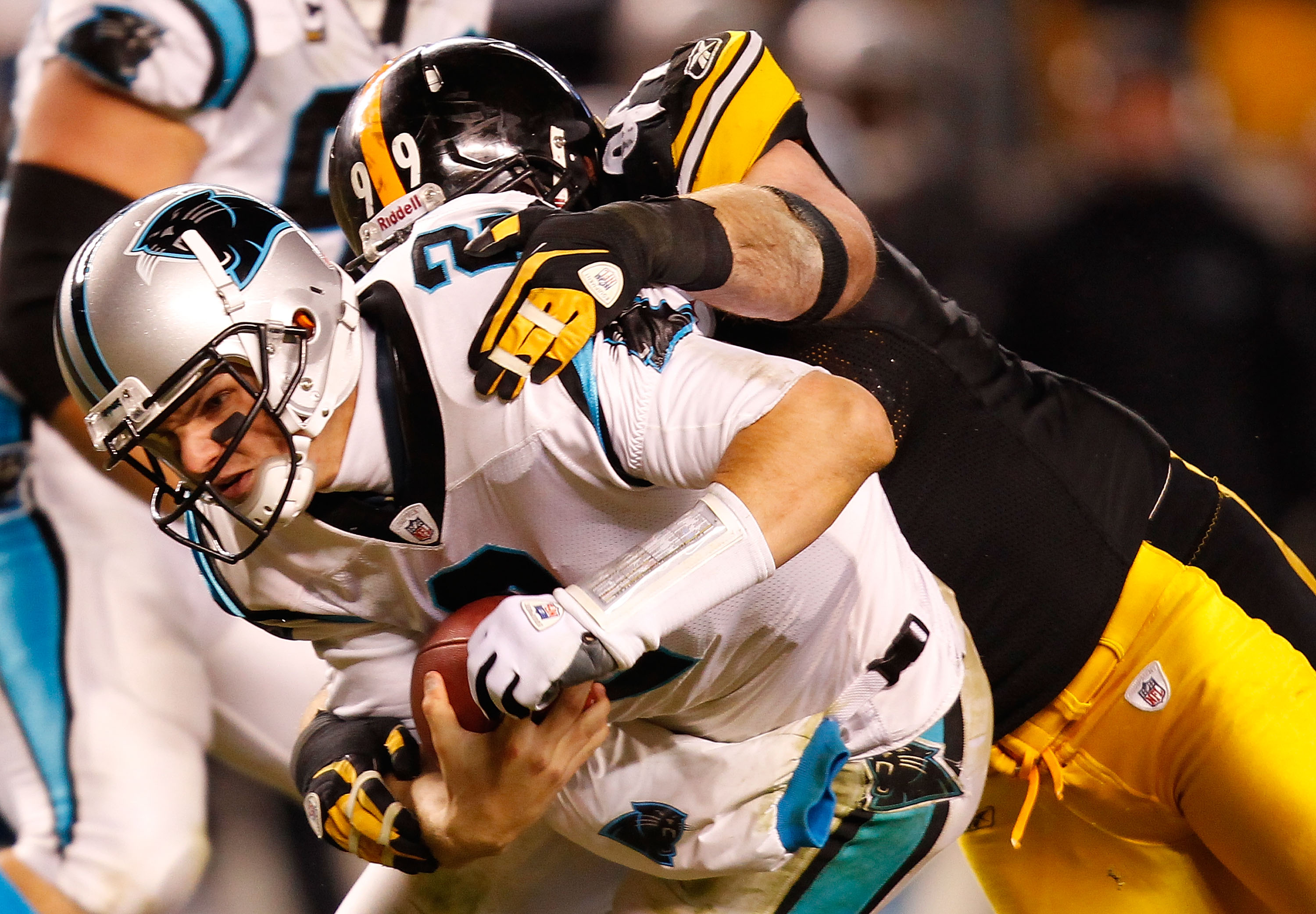 PITTSBURGH - DECEMBER 23:  Jimmy Clausen #2 of the Carolina Panthers is sacked by Brett Keisel #99 of the Pittsburgh Steelers during the game on December 23, 2010 at Heinz Field in Pittsburgh, Pennsylvania.  (Photo by Jared Wickerham/Getty Images)