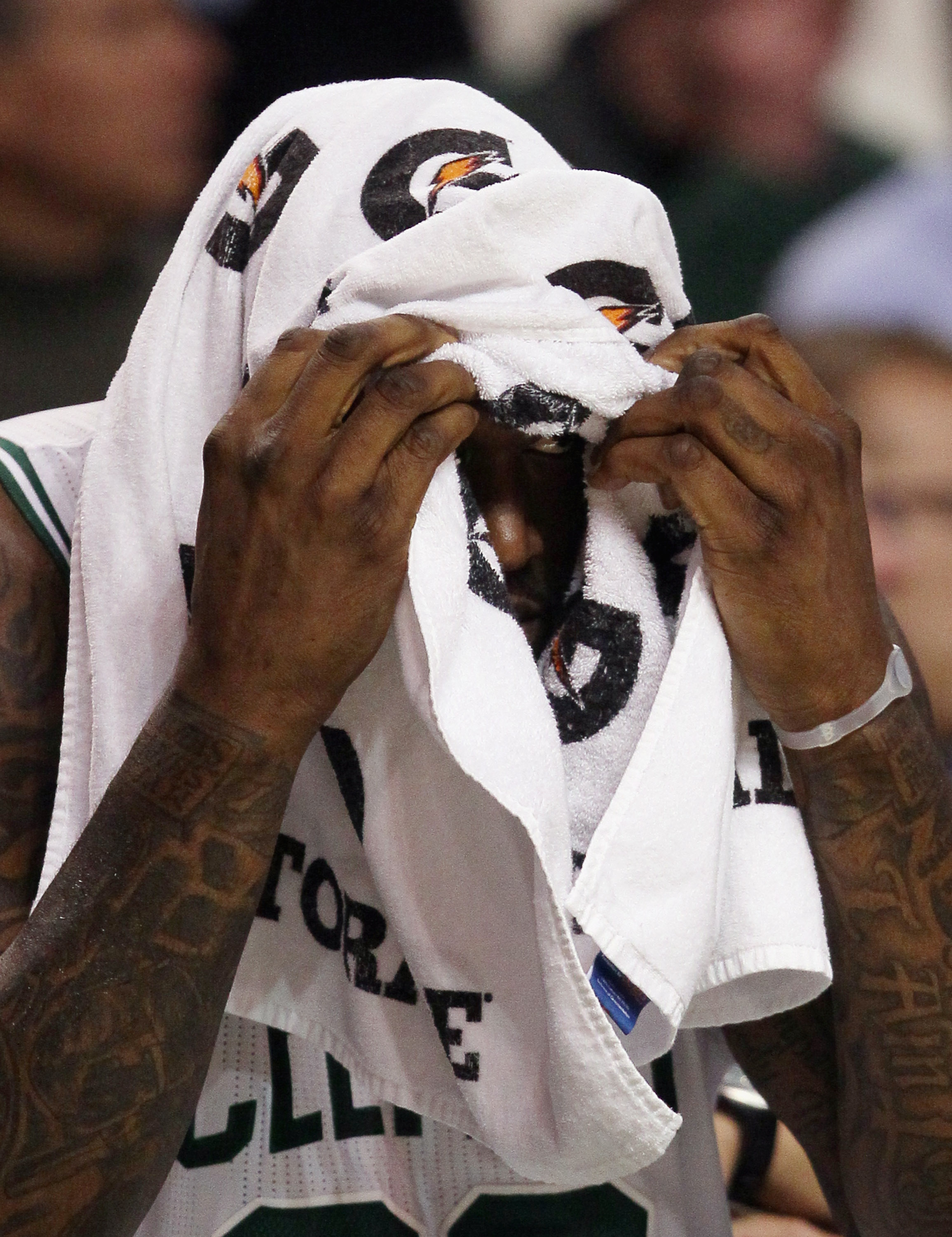 BOSTON, MA - JANUARY 03:  Shaquille O'Neal #36 of the Boston Celtics peaks out from under a towel in the second half against the Minnesota Timberwolves on January 3, 2011 at the TD Garden in Boston, Massachusetts. The Celtics defeated the Timberwolves 96-