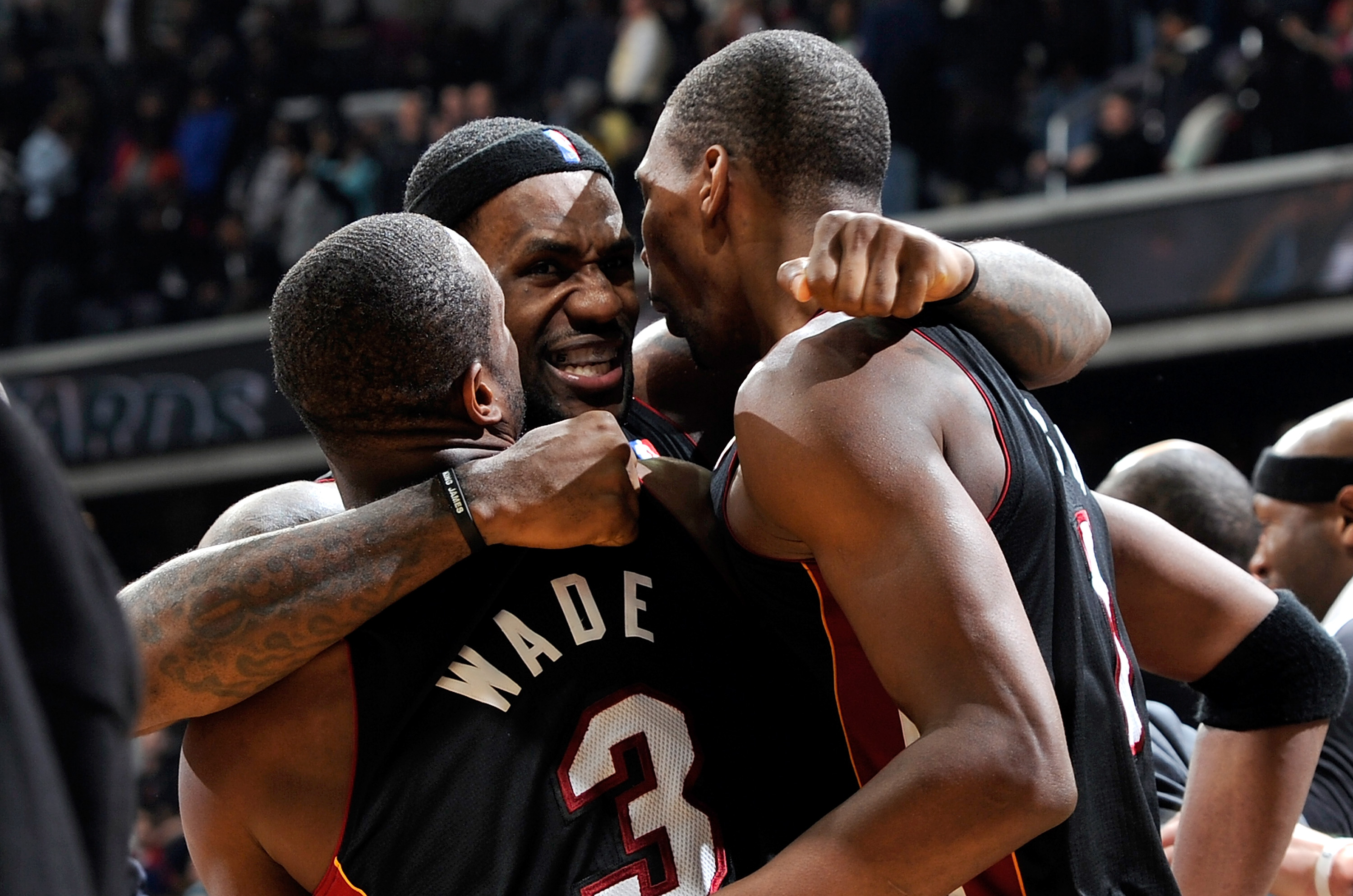 WASHINGTON - DECEMBER 18:  LeBron James #6 of the Miami Heat celebrates with Dwyane Wade #3 and Chris Bosh #1 after a 95-94 victory over the Washington Wizards at the Verizon Center on December 18, 2010 in Washington, DC. NOTE TO USER: User expressly ackn