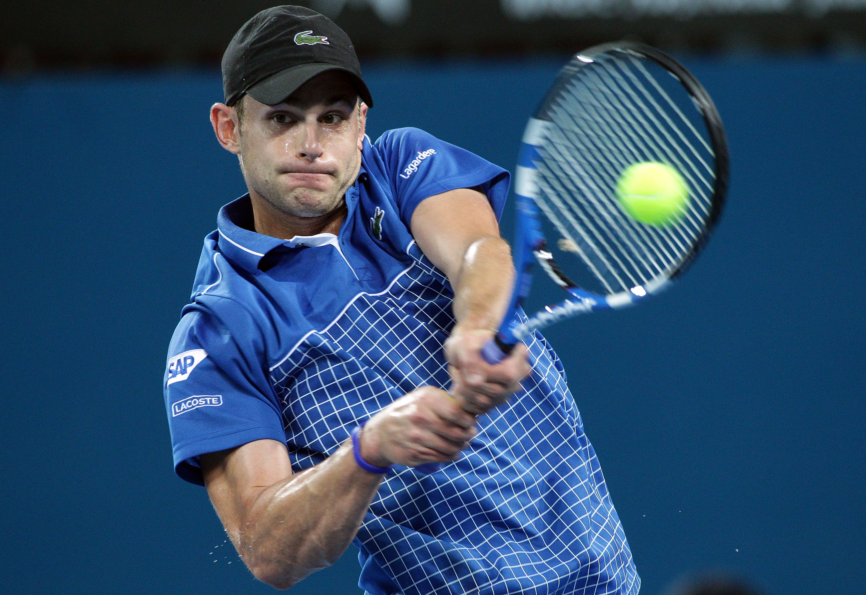 BRISBANE, AUSTRALIA - JANUARY 03:  Andy Roddick of the USA plays a backhand during his first round match against Marinko Matosevic of Australia during day two of the Brisbane International at Queensland Tennis Centre on January 3, 2011 in Brisbane, Austra
