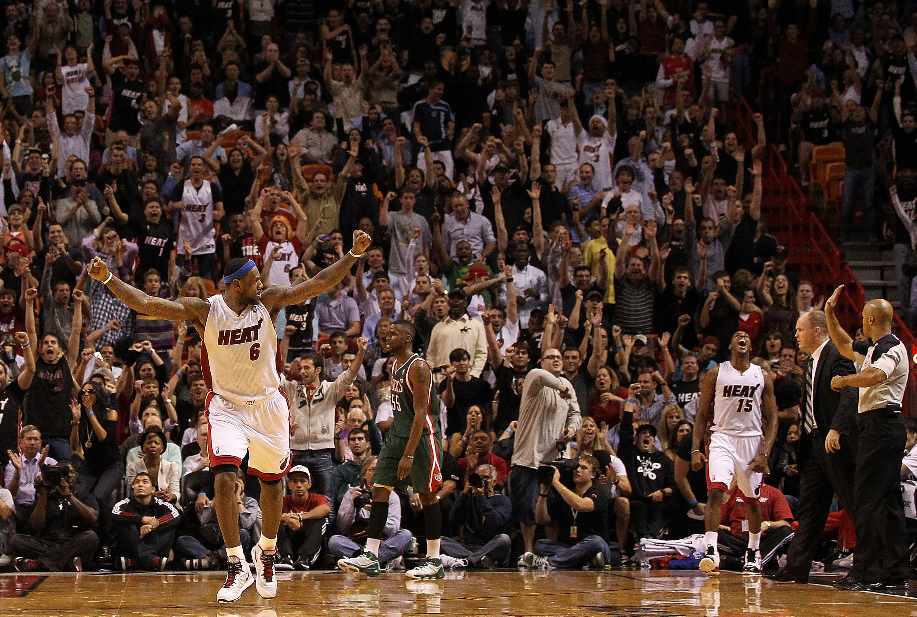 MIAMI, FL - JANUARY 04:  LeBron James #6 of the Miami Heat reacts after Mario Chalmers #15 hit a 3 pointer late in the game against the Milwaukee Bucks at American Airlines Arena on January 4, 2011 in Miami, Florida. NOTE TO USER: User expressly acknowled