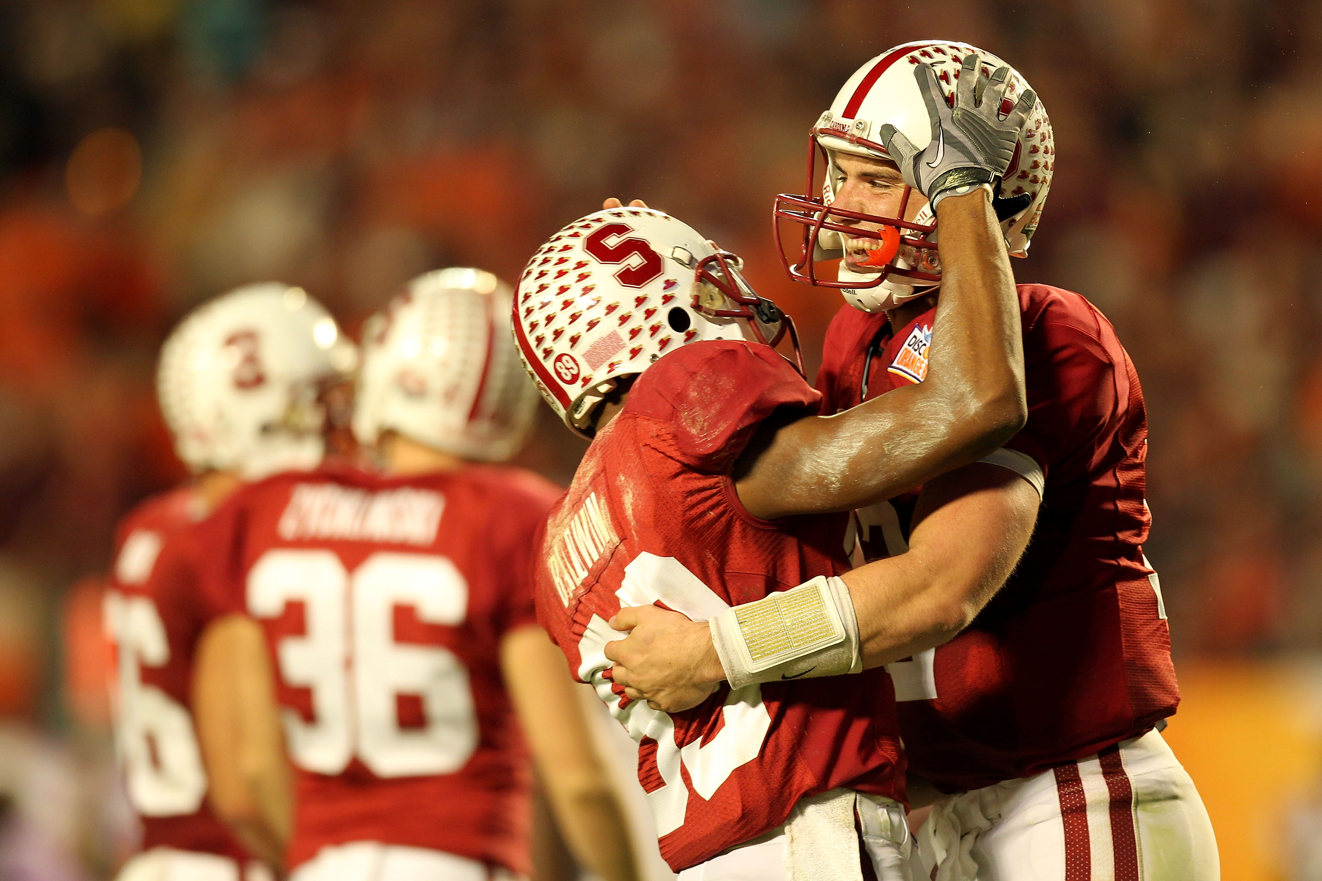 MIAMI, FL - JANUARY 03: Andrew Luck #12 (R) and Doug Baldwin #89 of the Stanford Cardinal celebrate after Luck threw a 41-yard touchdown pass to Coby Fleener #82 in the third quarter against the Virginia Tech Hokies during the 2011 Discover Orange Bowl at