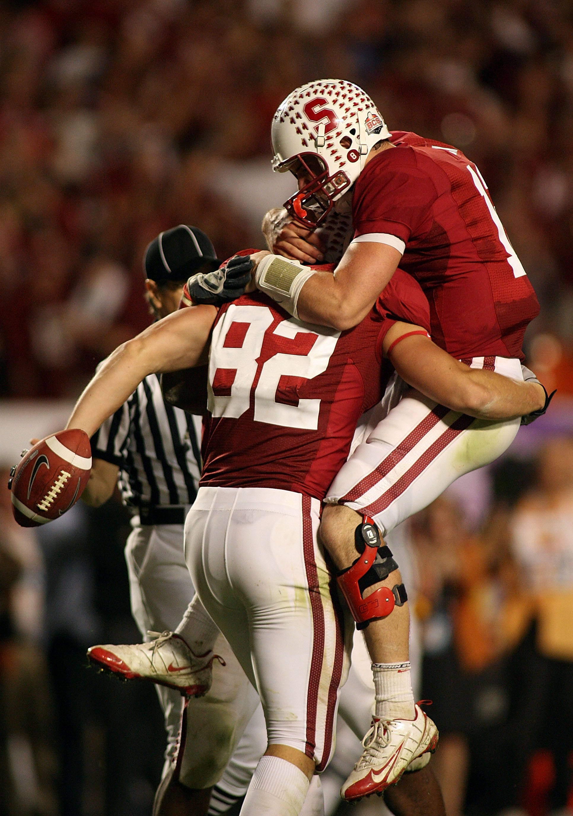 MIAMI, FL - JANUARY 03: Quarterback Andrew Luck #12 and Colby Fleener #82 of the Stanford Cardinal celebrate after Luck threw Fleener a 41-yard touchdown pass in the third quarterback against the Virginia Tech Hokies during the 2011 Discover Orange Bowl a