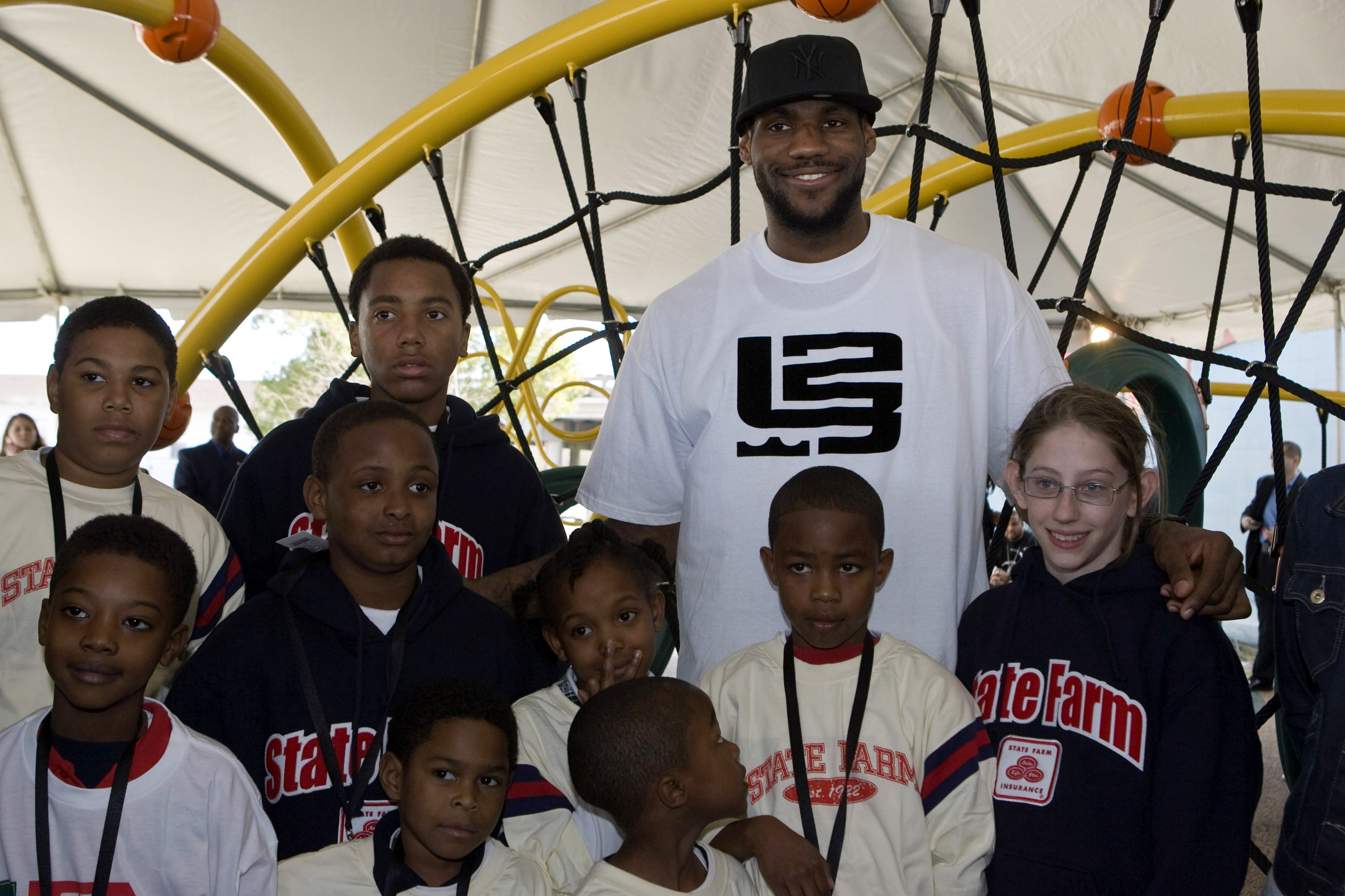 NEW ORLEANS - FEBRUARY 14:  LeBron James of the Cleveland Cavaliers poses with neighborhood children at a playground dedication by State Farm Insurance and the LeBron James Family Foundation at the St. Bernard Recreation Center February 14, 2008 in New Or