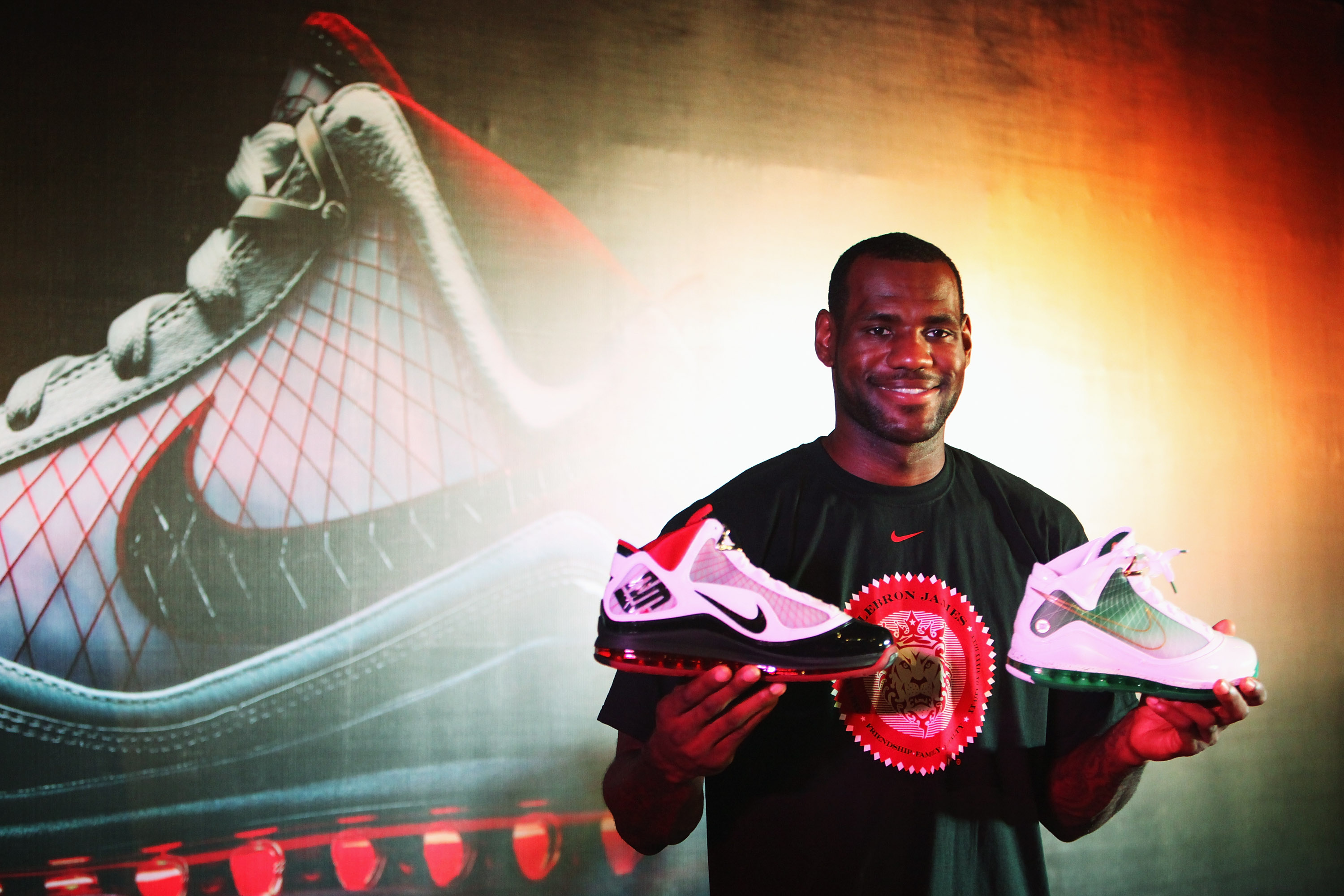 BEIJING - AUGUST 24:  LeBron James of the Cleveland Cavaliers shows the new Nike shoes in a promotional event during a visit to China on August 24, 2009 in Beijing, China.  (Photo by Feng Li/Getty Images)