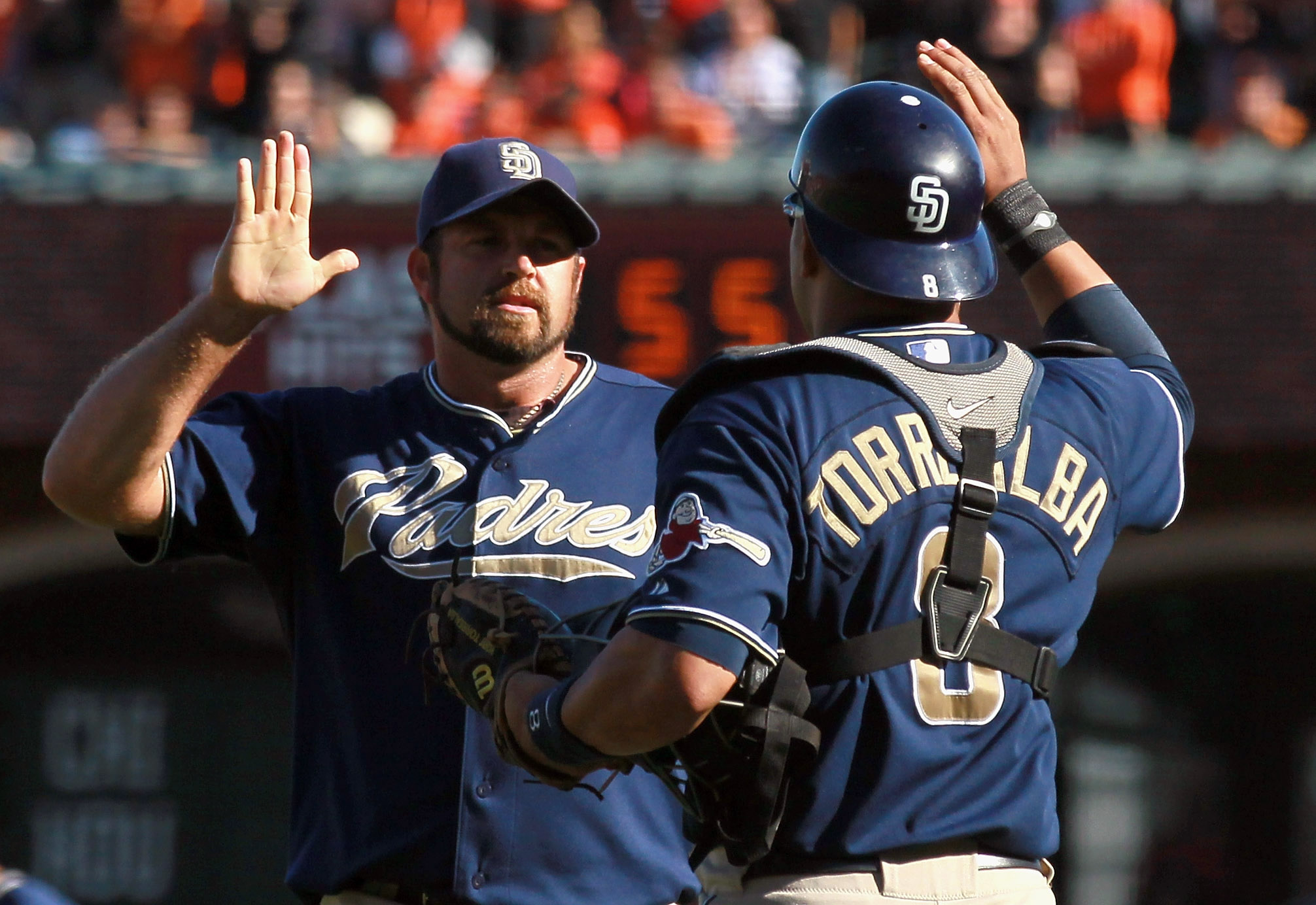 SAN FRANCISCO - OCTOBER 02:  Heath Bell #21 of the San Diego Padres is congratulated by teammate Yorvit Torrealba #8 at the end of the game against the San Francisco Giants at AT&T Park on October 2, 2010 in San Francisco, California. The Padres beat the