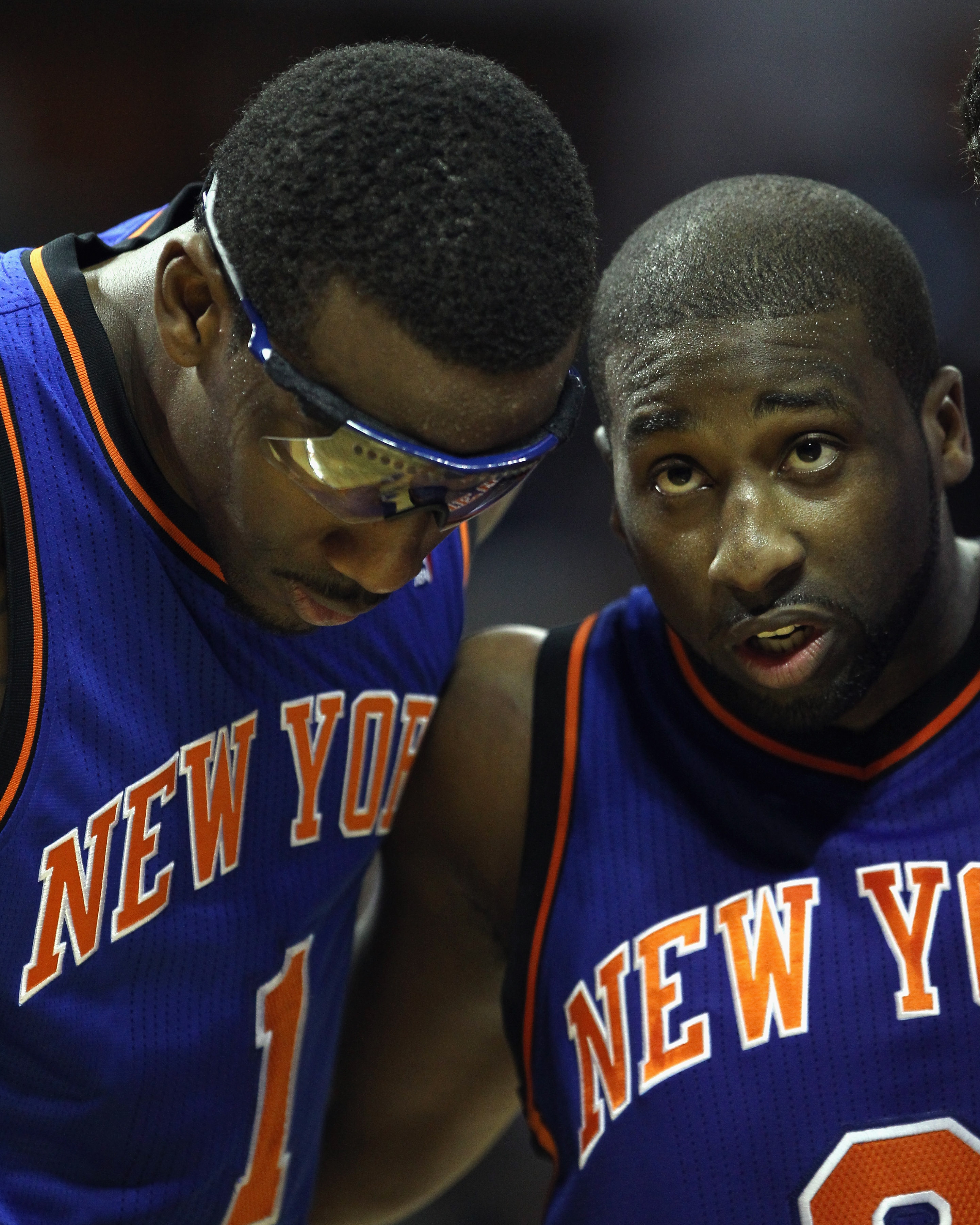 CHARLOTTE, NC - NOVEMBER 24:  Amare Stoudemire #1 of the New York Knicks and teammate Raymond Felton #2 huddle up against the Charlotte Bobcats at Time Warner Cable Arena on November 24, 2010 in Charlotte, North Carolina.  NOTE TO USER: User expressly ack