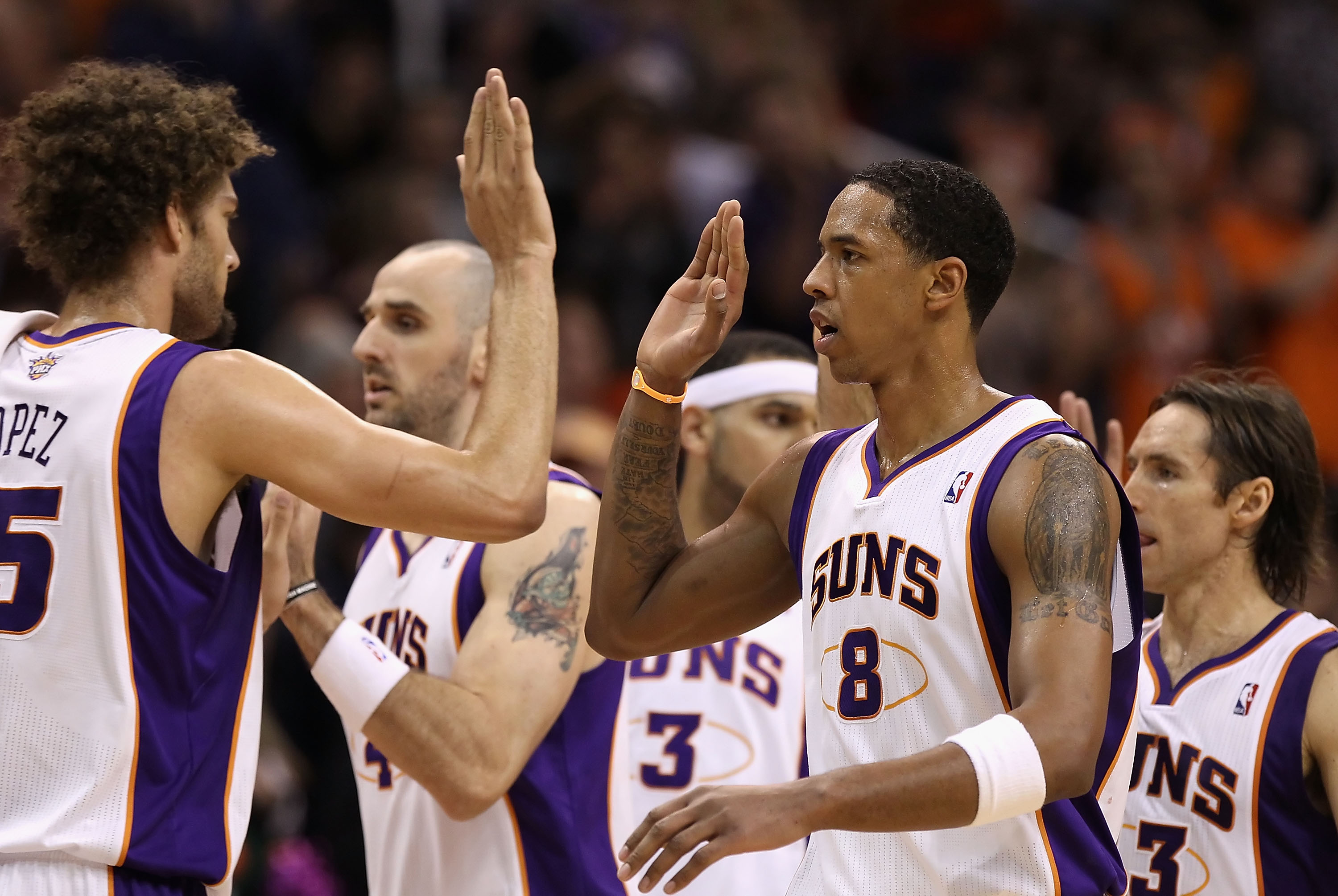 PHOENIX - DECEMBER 23:  Channing Frye #8 of the Phoenix Suns high fives teammates during the NBA game against the Miami Heat at US Airways Center on December 23, 2010 in Phoenix, Arizona.  The Heat defeated the Suns 95-83.  NOTE TO USER: User expressly ac