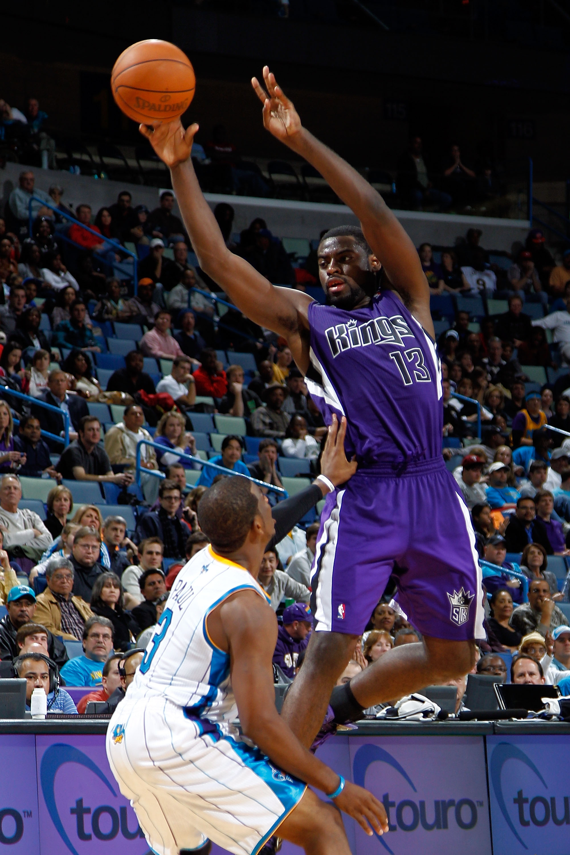 NEW ORLEANS, LA - DECEMBER 15:  Tyreke Evans #13 of the Sacramento Kings passes the ball over Chris Paul #3 of the New Orleans Hornets  at the New Orleans Arena on December 15, 2010 in New Orleans, Louisiana.  The Hornets defeated the Kings 94-91.  NOTE T