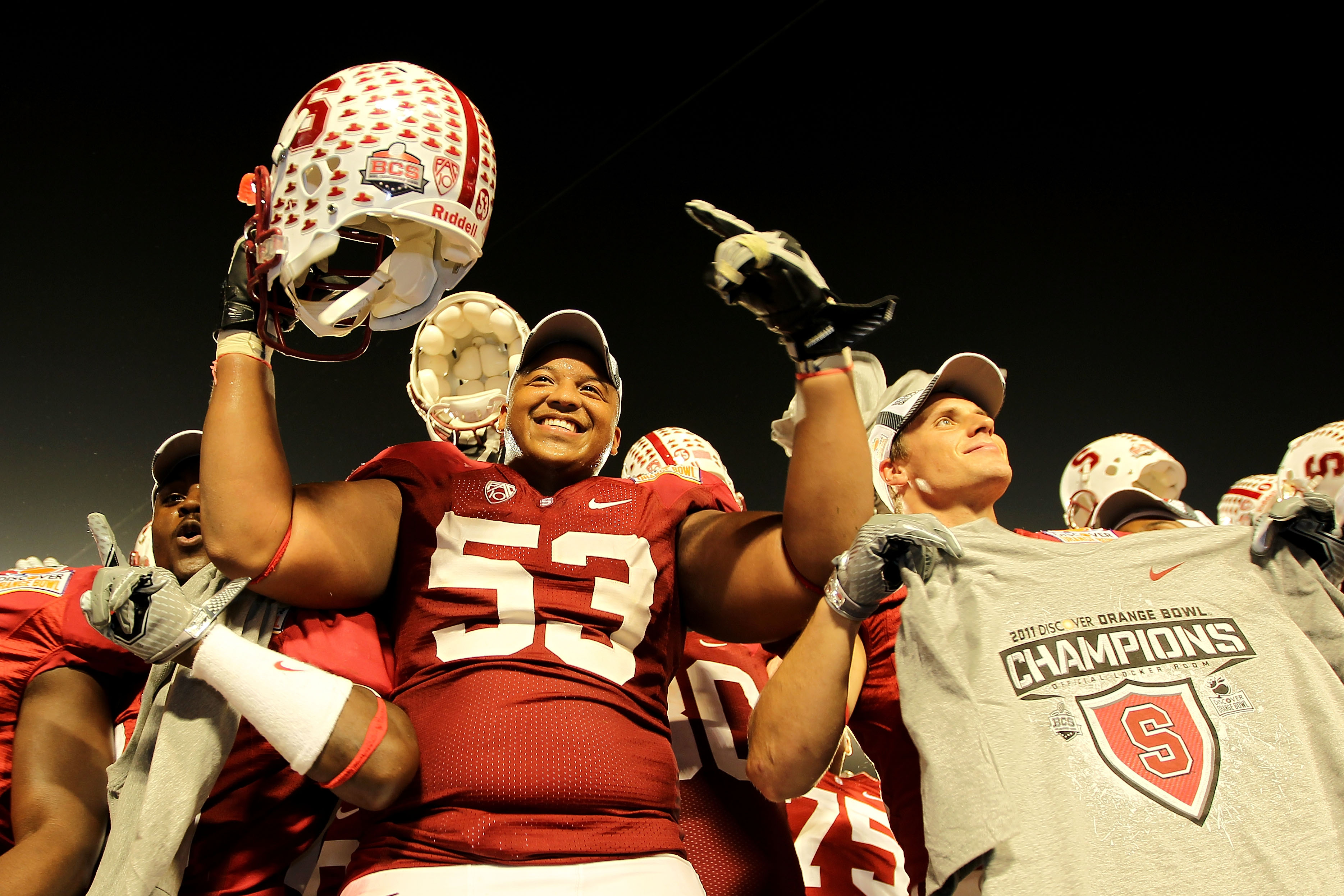 MIAMI, FL - JANUARY 03: Derek Hall #53 of the Stanford Cardinal celebrates with teammates after Stanford won 40-12 against the Virginia Tech Hokies during the 2011 Discover Orange Bowl at Sun Life Stadium on January 3, 2011 in Miami, Florida. (Photo by Mi