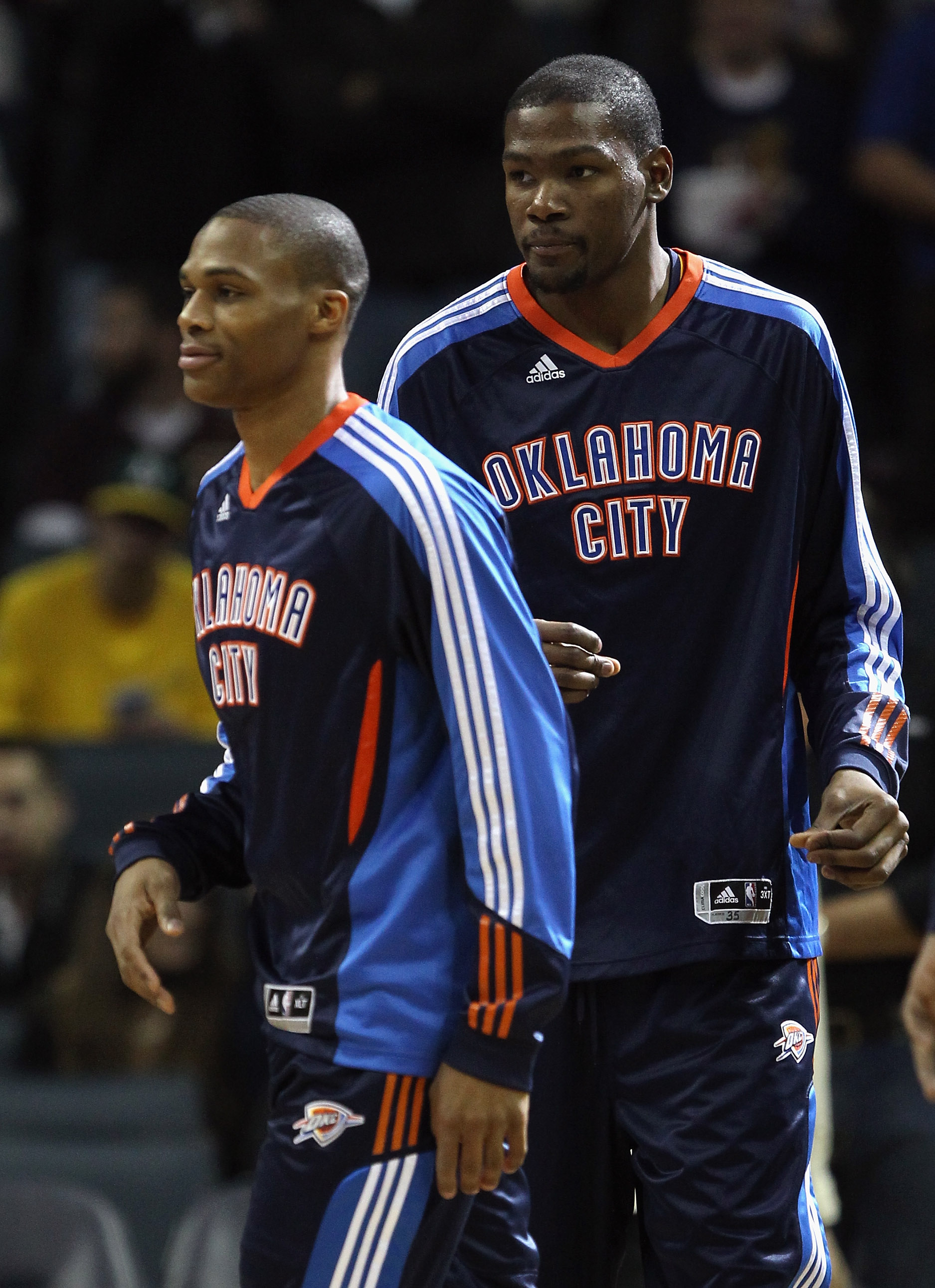 CHARLOTTE, NC - DECEMBER 21:  Teammates Kevin Durant #35 and Russell Westbrook #0 of the Oklahoma Thunder warmup before the start of their game against the Charlotte Bobcats at Time Warner Cable Arena on December 21, 2010 in Charlotte, North Carolina. NOT