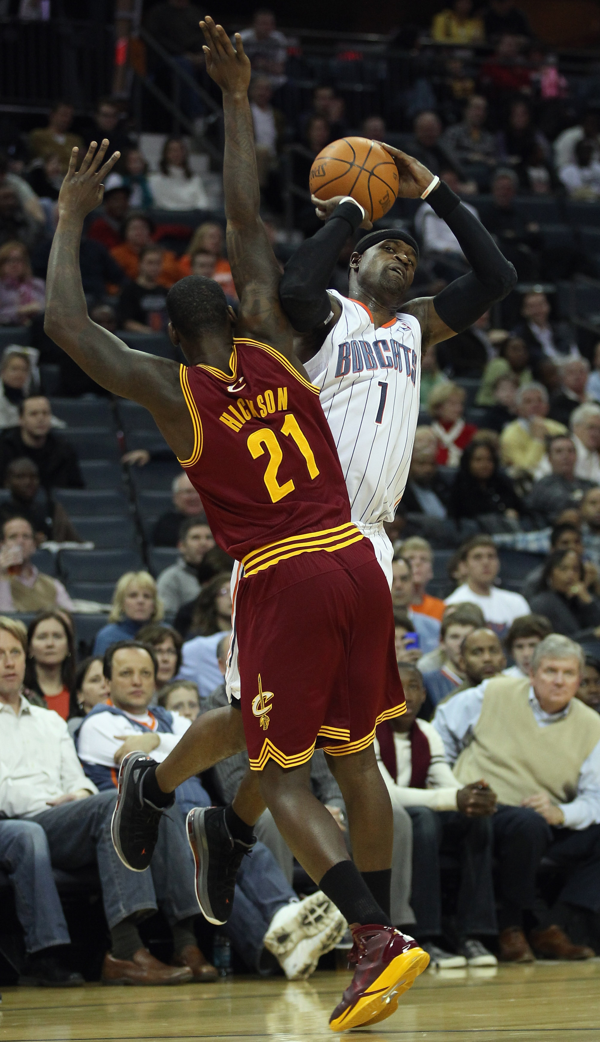 CHARLOTTE, NC - DECEMBER 29:  Stephen Jackson #1 of the Charlotte Bobcats is hit as he shoots by J.J. Hickson #21 of the Cleveland Cavaliers during their game at Time Warner Cable Arena on December 29, 2010 in Charlotte, North Carolina. NOTE TO USER: User