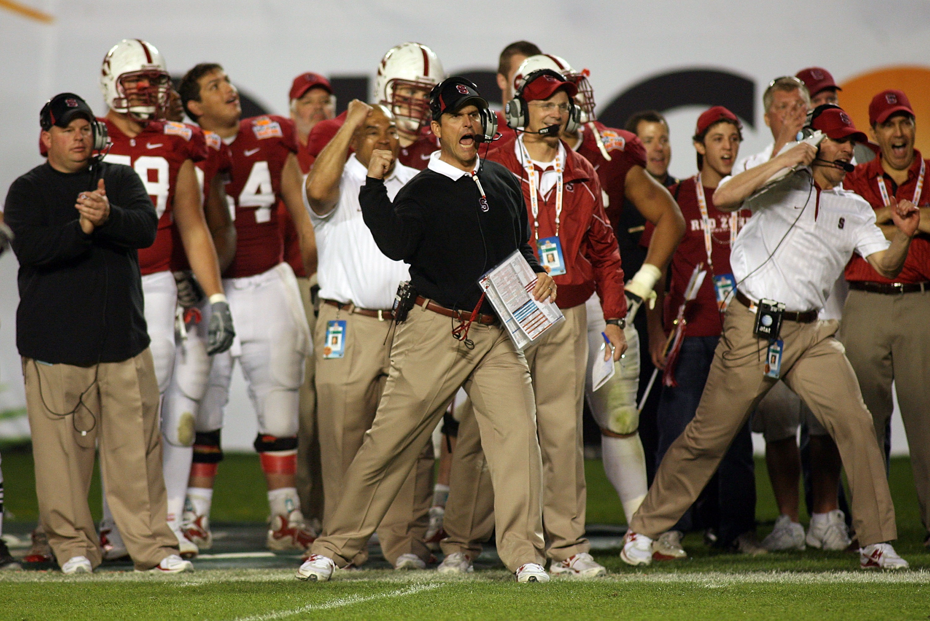 MIAMI, FL - JANUARY 03: Head coach Jim Harbaugh of the Stanford Cardinal reacts as he coaches against the Virginia Tech Hokies during the 2011 Discover Orange Bowl at Sun Life Stadium on January 3, 2011 in Miami, Florida. Stanford won 40-12. (Photo by Mar