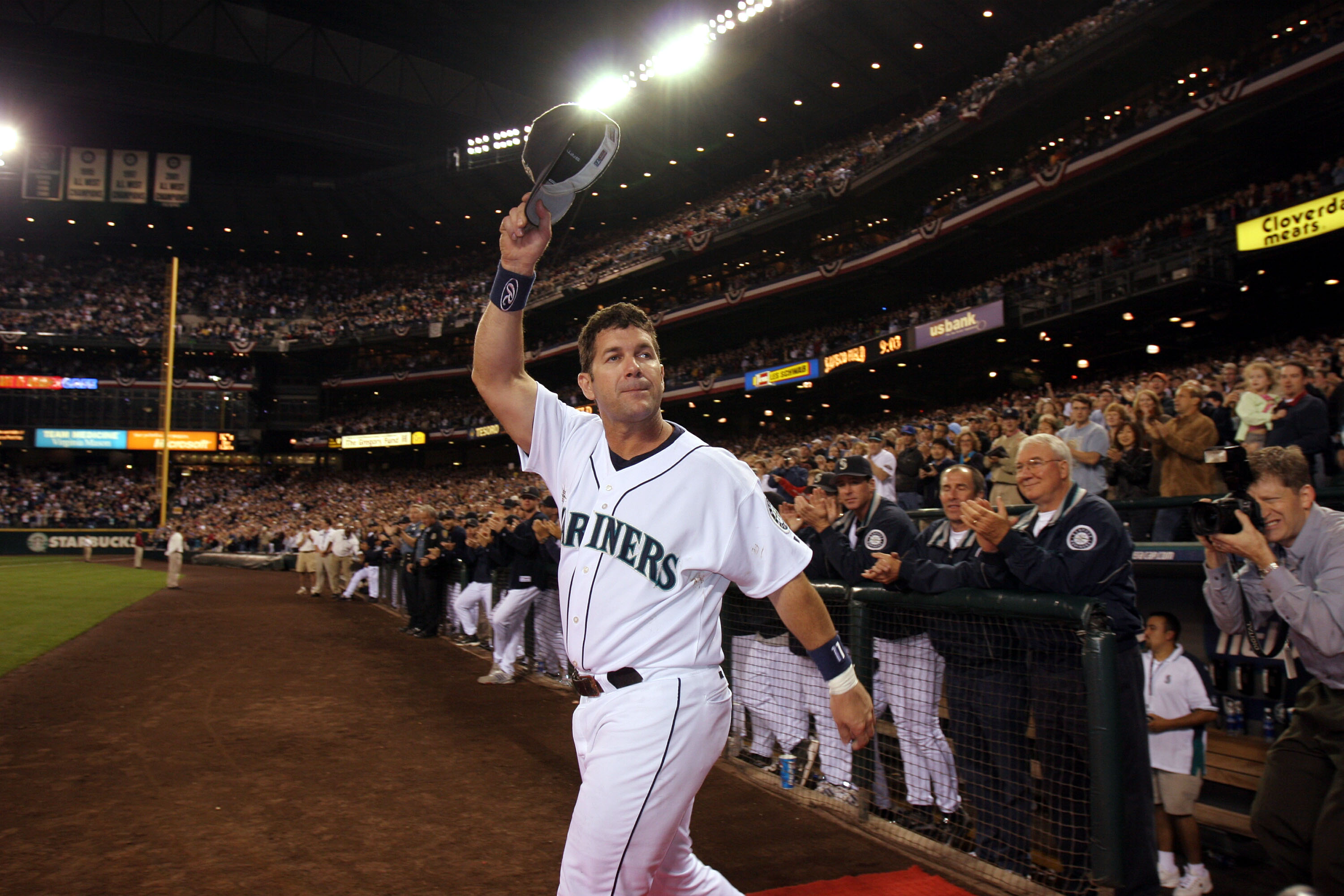 SEATTLE - OCTOBER 2:  Edgar Martinez #11 of the Seattle Mariners waves to fans as he takes the field during a post game ceremony honoring his career as a Mariner after the game against the Seattle Mariners on October 2, 2004 at Safeco Field in Seattle, Wa