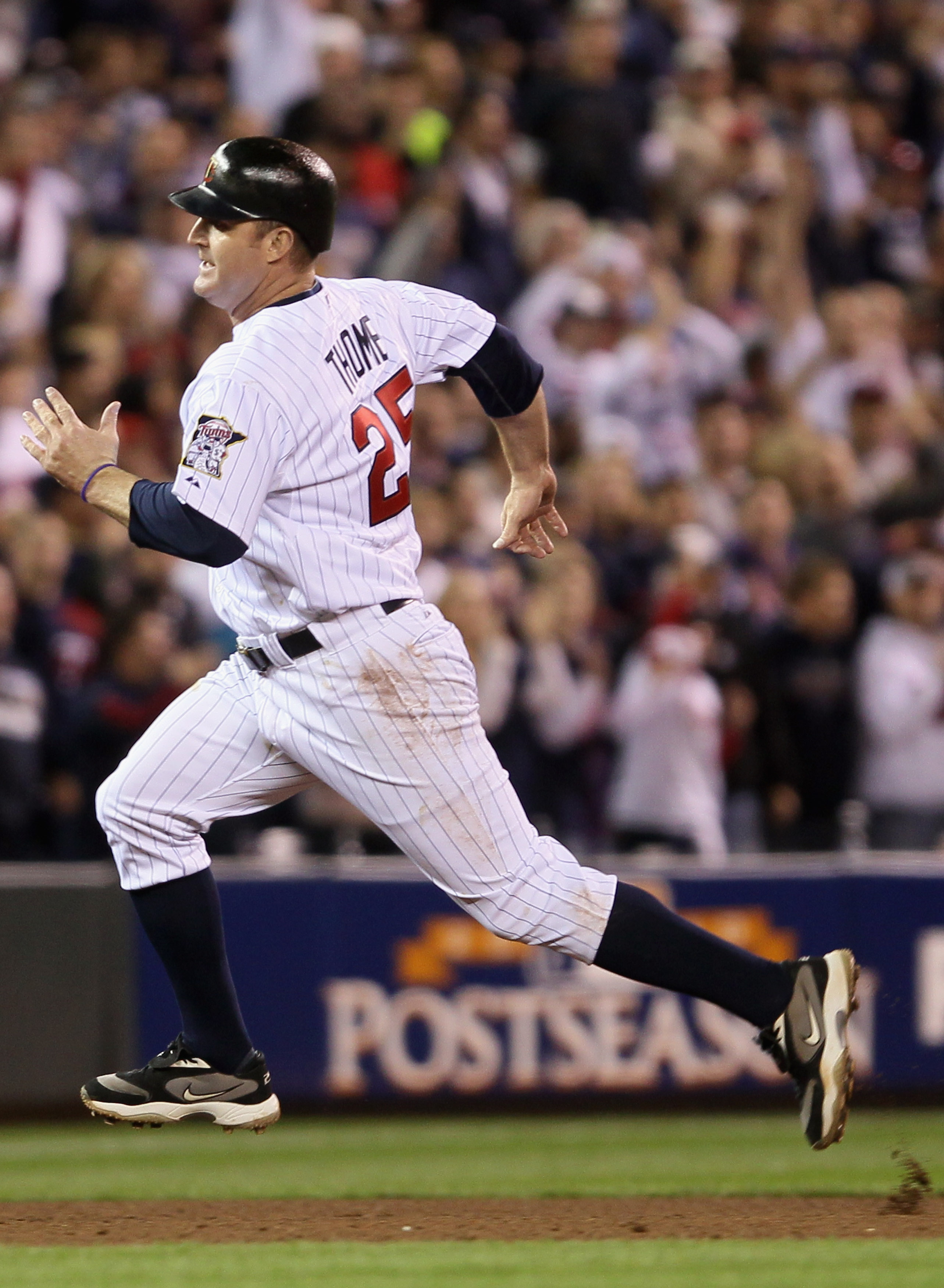 MINNEAPOLIS - OCTOBER 06: Jim Thome #25 of the Minnesota Twins rounds third base against the New York Yankees during game one of the ALDS on October 6, 2010 at Target Field in Minneapolis, Minnesota.  (Photo by Elsa/Getty Images)