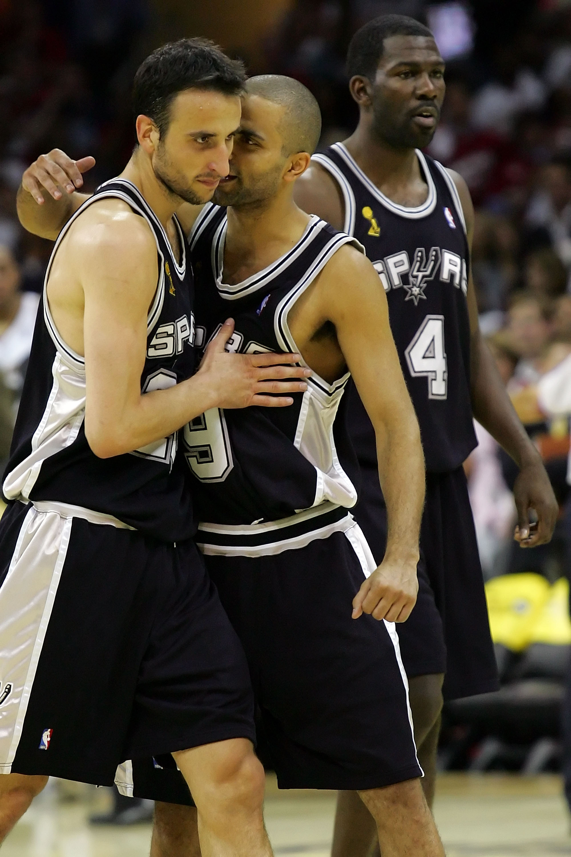 CLEVELAND - JUNE 14:  Tony Parker #9, Manu Ginobili #20 and Michael Finley #4 of the San Antonio Spurs react after winning the NBA Championship after Game Four of the NBA Finals against the Cleveland Cavaliers on June 14, 2007 at the Quicken Loans Arena i