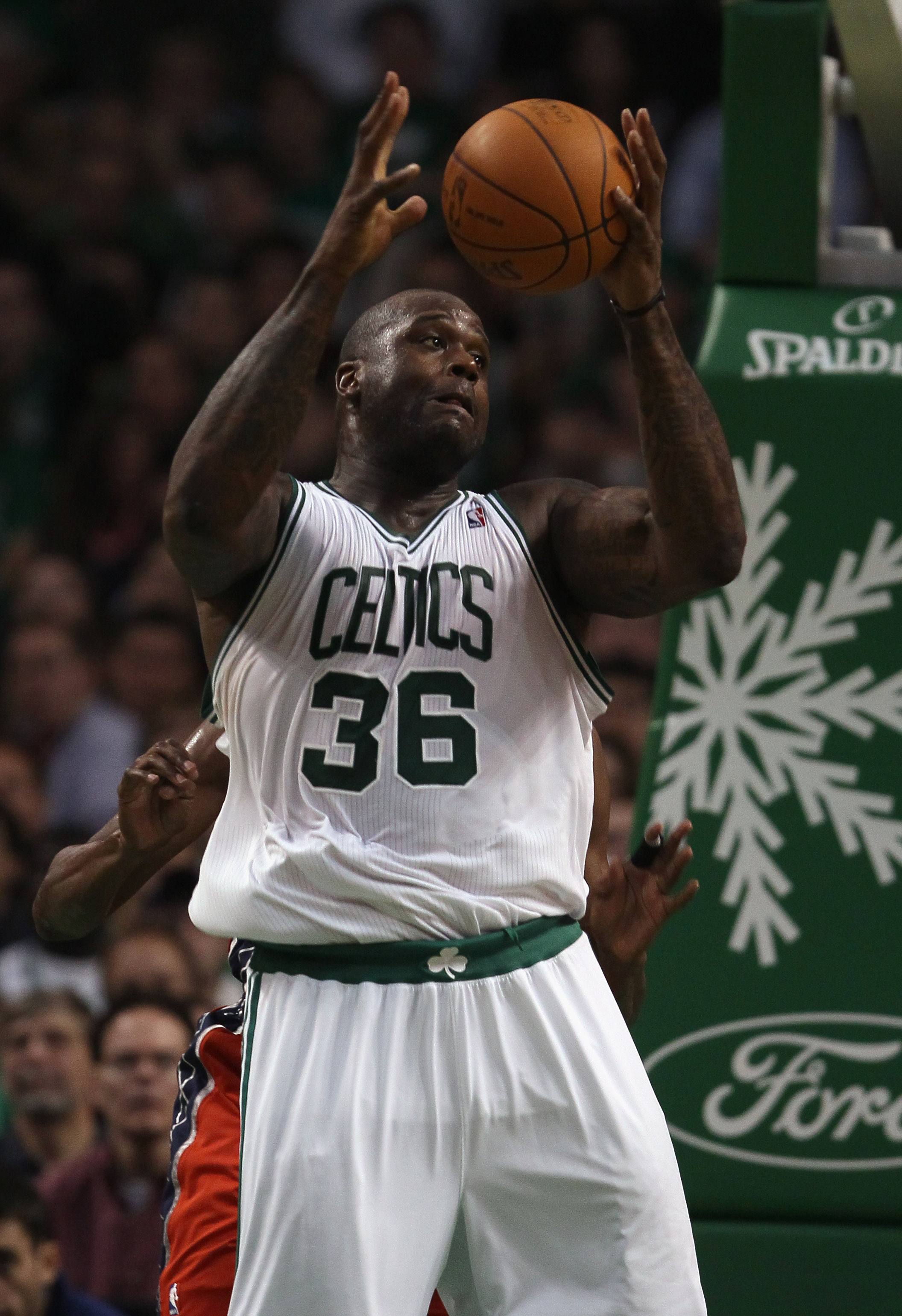 BOSTON - NOVEMBER 24:  Shaquille O'Neal #36 of the Boston Celtics grabs the ball in the second half against the New Jersey Nets on November 24, 2010 at the TD Garden in Boston, Massachusetts. The Celtics defeated the nets 89-83. NOTE TO USER: User express
