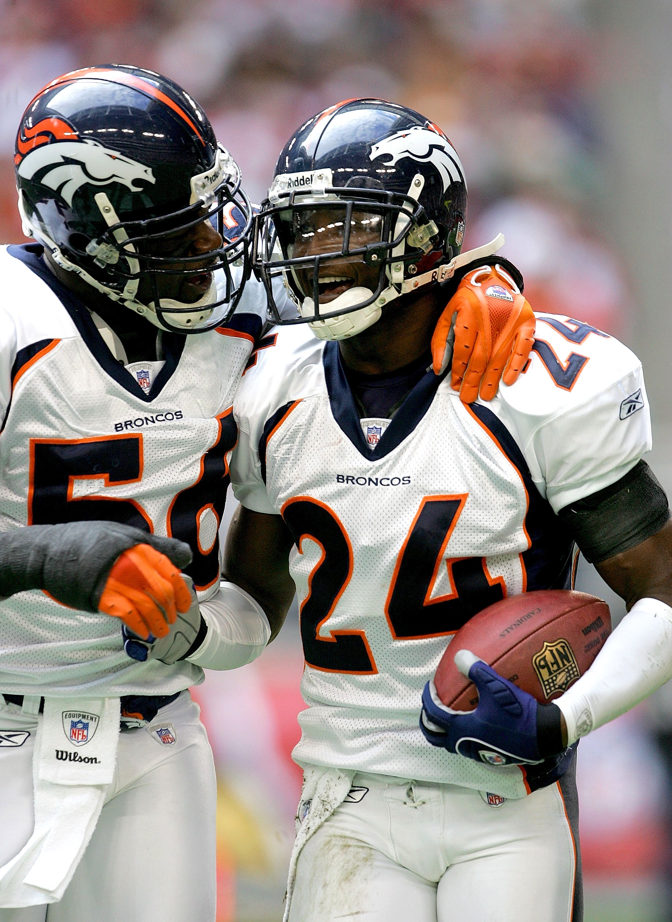 GLENDALE, AZ - DECEMBER 17: Cornerback Champ Bailey #24 and linebacker Al Wilson #56 of the Denver Broncos celebrate after Bailey's first quarter pass interception against the Arizona Cardinals on December 17, 2006 at University of Phoenix Stadium in Glen