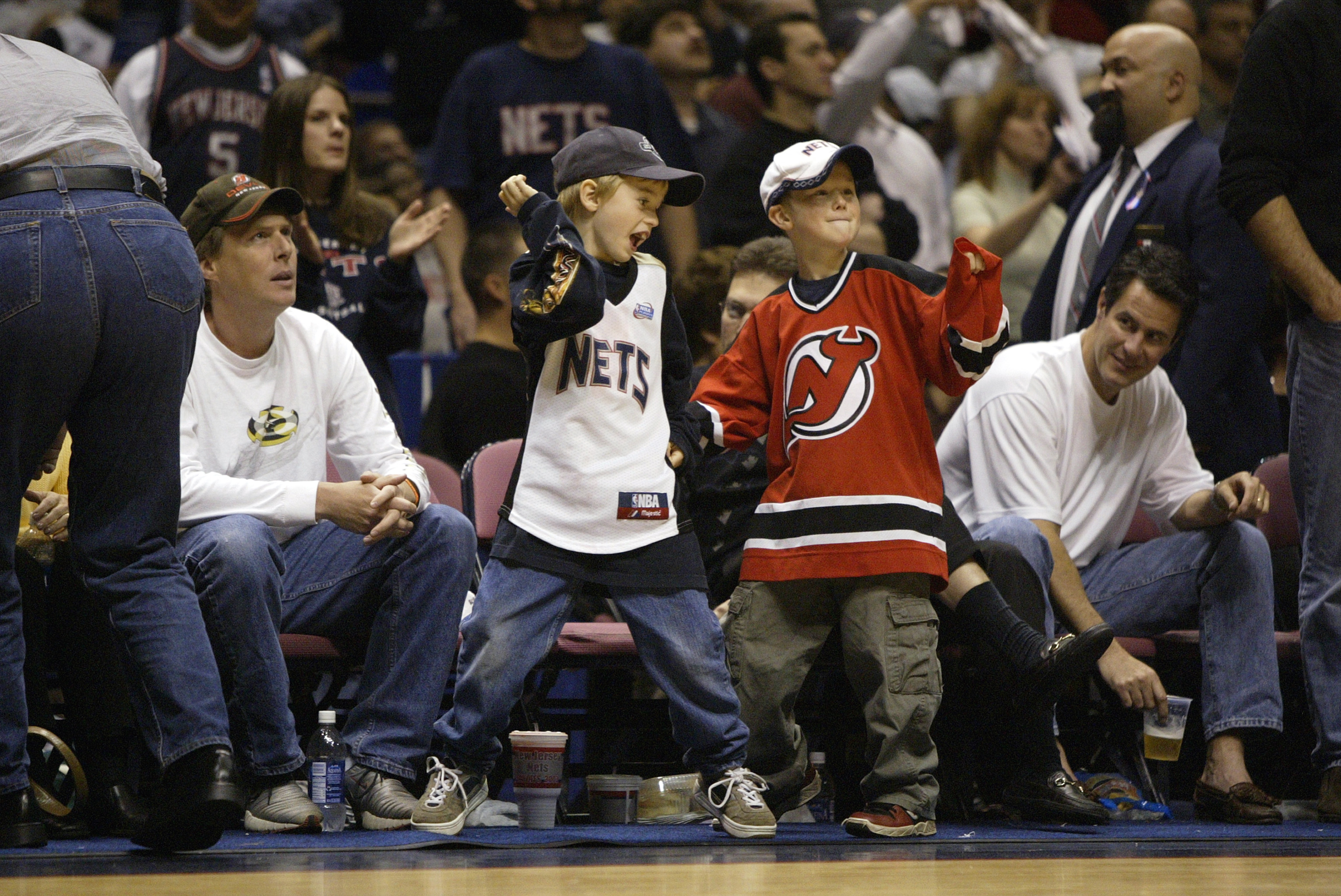 EAST RUTHERFORD, NJ - MAY 24:  Young New Jersey fans show support for the New Jersey Nets and the New Jersey Devils in Game four of the Eastern Conference Finals during the 2003 NBA Playoffs between the Nets and the Detroit Pistons at Continental Airlines