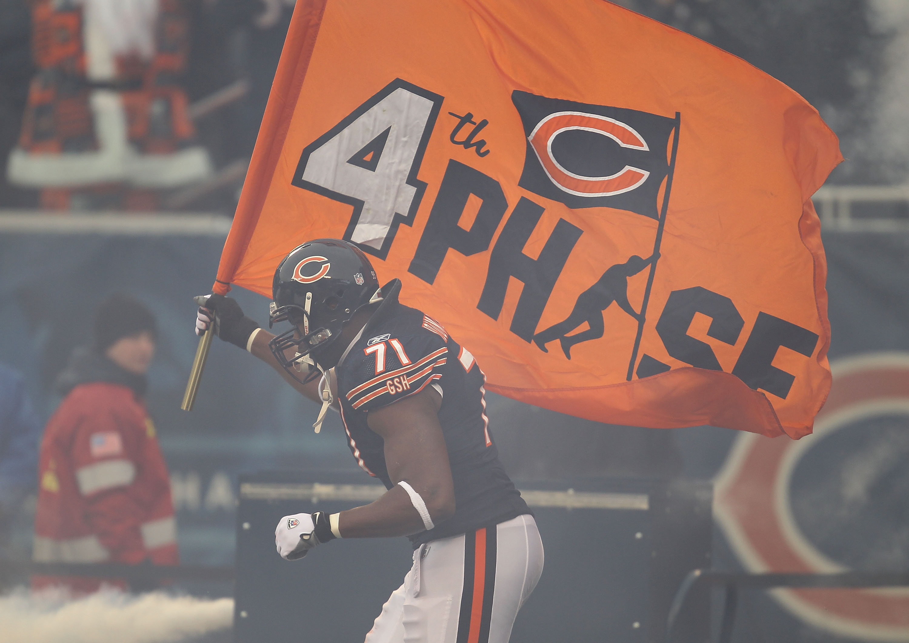 CHICAGO, IL - DECEMBER 26: Israel Idonije #71 of the Chicago Bears runs onto the field during player introductions before a game against the New York Jets at Soldier Field on December 26, 2010 in Chicago, Illinois. The Bears defeated the Jets 38-34. (Phot