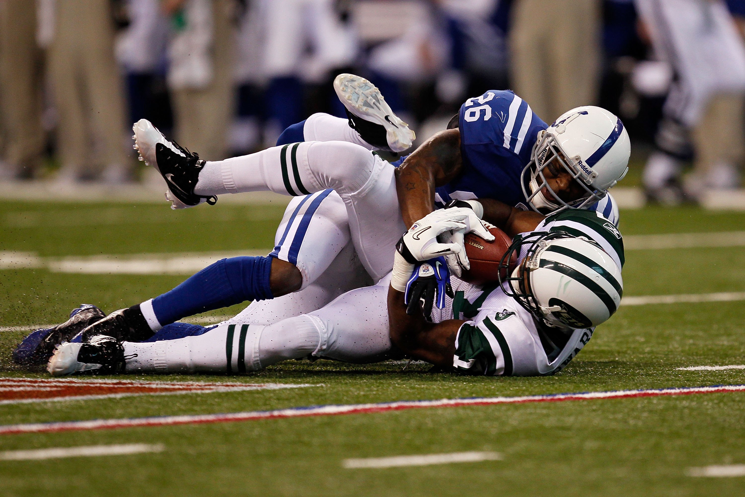 INDIANAPOLIS - JANUARY 24:  Wide receiver Braylon Edwards #17 of the New York Jets is tackled by Kelvin Hayden #26 of the Indianapolis Colts during the AFC Championship Game at Lucas Oil Stadium on January 24, 2010 in Indianapolis, Indiana.  (Photo by Jon