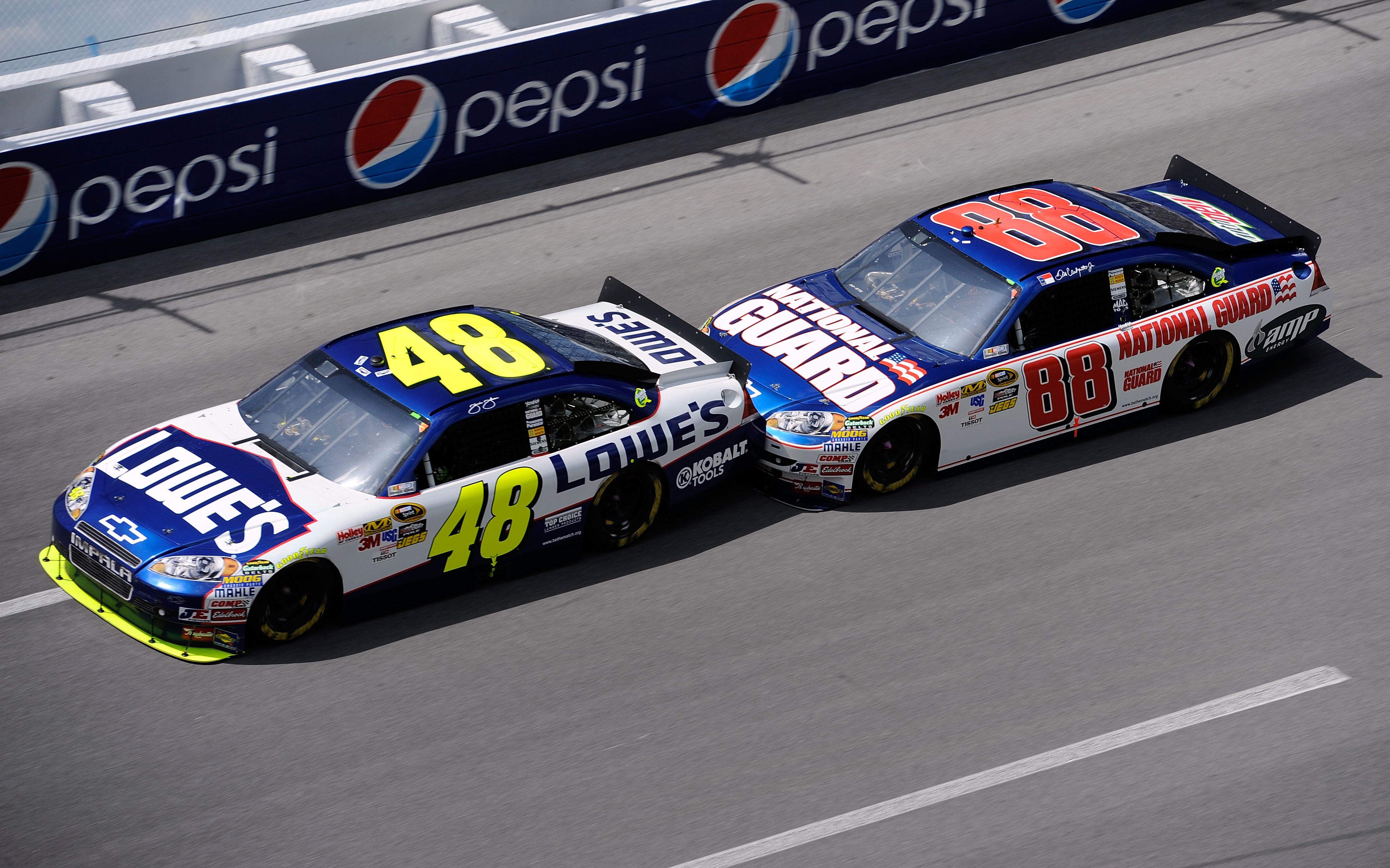 TALLADEGA, AL - APRIL 25:  Jimmie Johnson, driver of the #48 Lowe's Chevrolet, gets bump drafted by Dale Earnhardt Jr., driver of the #88 National Guard/AMP Energy Chevrolet, during the NASCAR Sprint Cup Series Aaron's 499 at Talladega Superspeedway on Ap