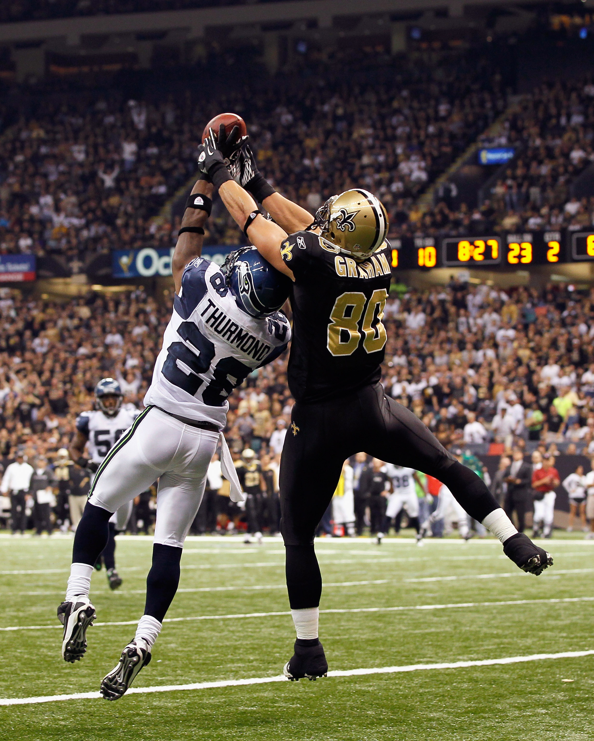 NEW ORLEANS - NOVEMBER 21:  Walter Thurmond #28 of the Seattle Seahawks breaks up a touchdown reception intended for Jimmy Graham #80 of the New Orleans Saints at Louisiana Superdome on November 21, 2010 in New Orleans, Louisiana.  (Photo by Kevin C. Cox/