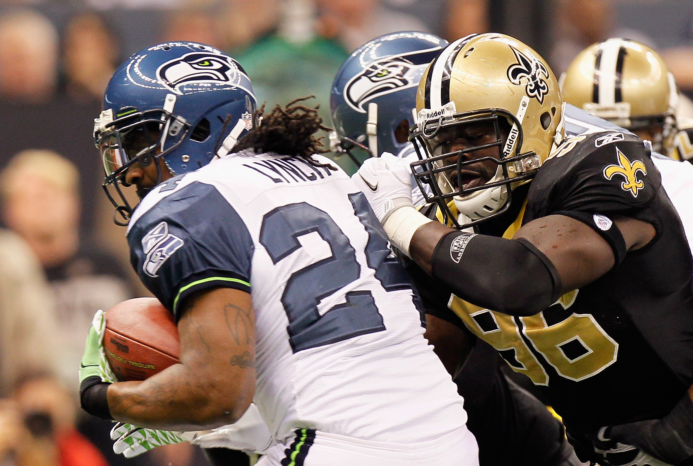 NEW ORLEANS - NOVEMBER 21:  Marshawn Lynch #24 of the Seattle Seahawks against Alex Brown #96 of the New Orleans Saints at Louisiana Superdome on November 21, 2010 in New Orleans, Louisiana.  (Photo by Kevin C. Cox/Getty Images)