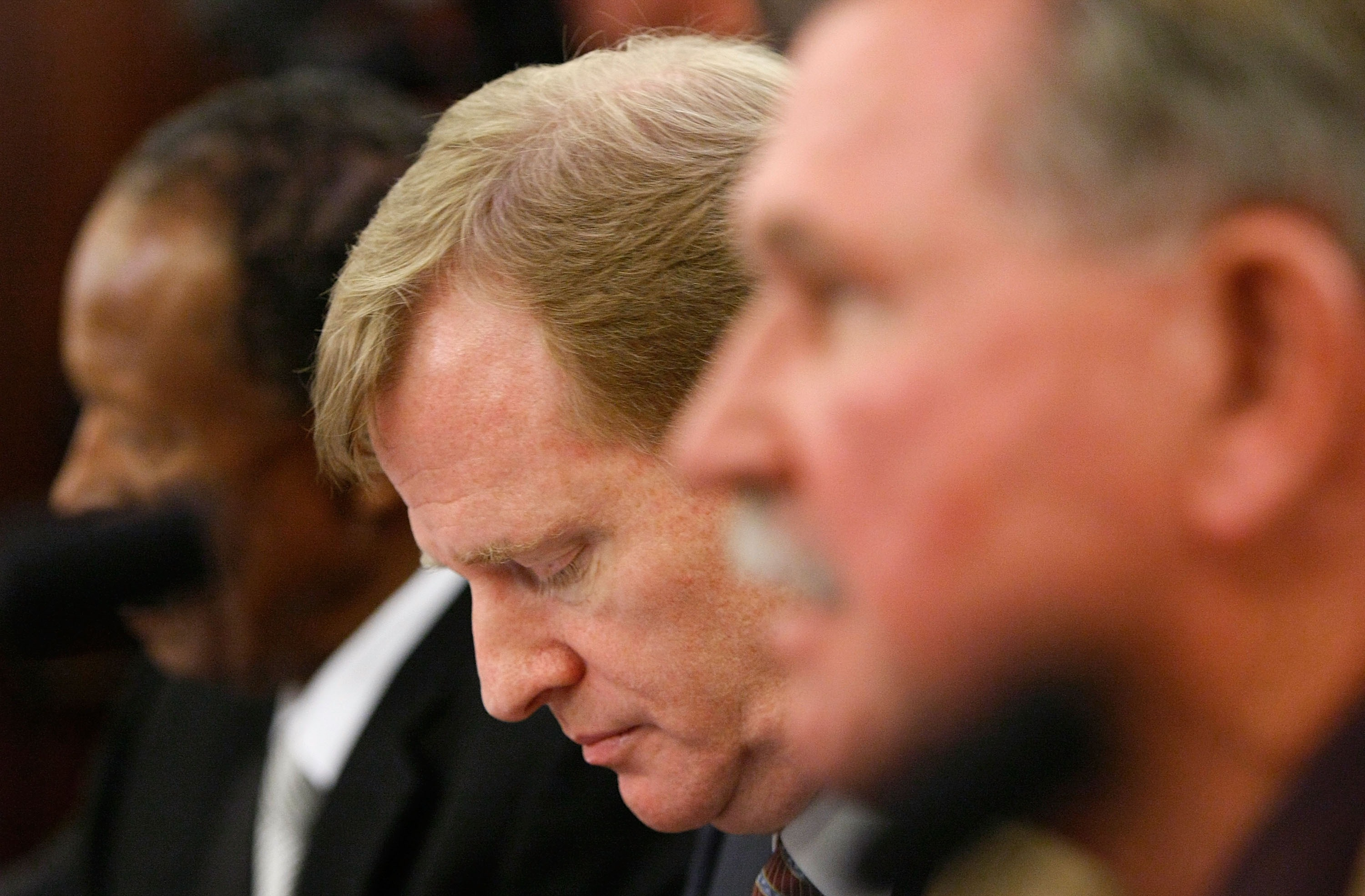 WASHINGTON - SEPTEMBER 18:  NFL Commissioner Roger Goodell (C) listens to testimony during a hearing of the Senate Commerce, Science and Transportation Committee with NFL Players Association Executive Director Gene Upshaw (L) and Pro Football Hall of Fame