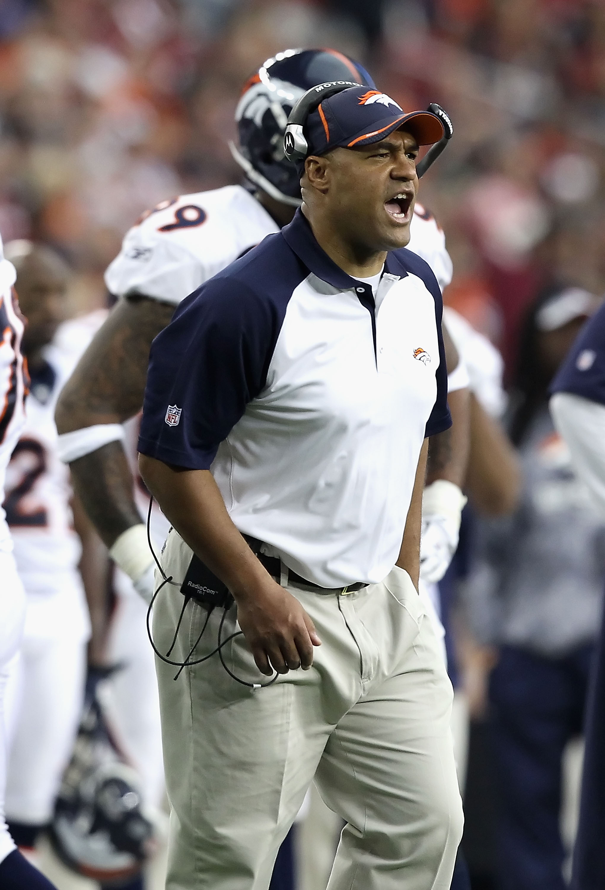 GLENDALE, AZ - DECEMBER 12:  Interim head coach Eric Studesville of the Denver Broncos reacts during the NFL game against the Arizona Cardinals at the University of Phoenix Stadium on December 12, 2010 in Glendale, Arizona. The Cardinals defeated the Bron
