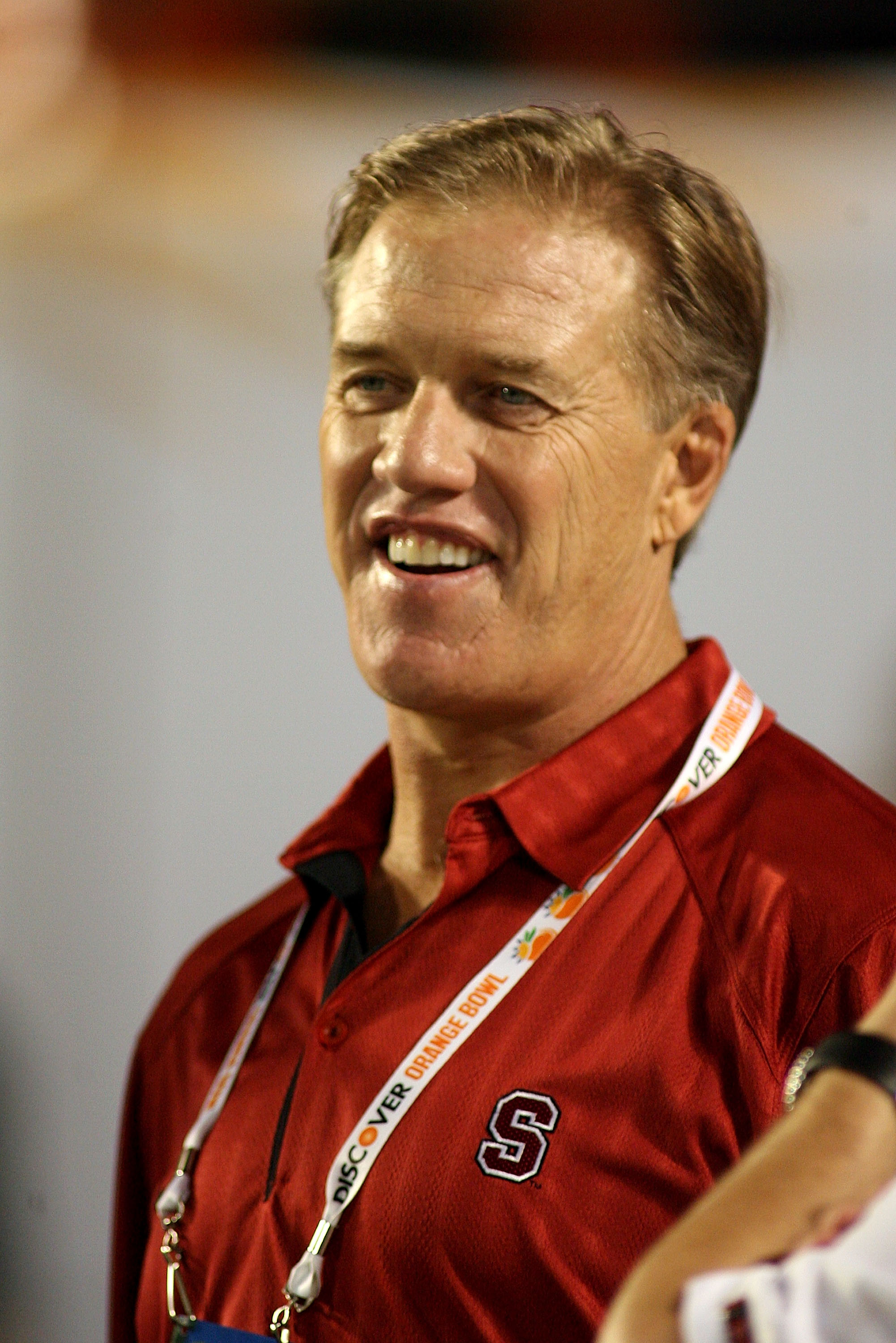 MIAMI, FL - JANUARY 03:  Stanford alum John Elway stands on the Stanford Cardinal sideline against the Virginai Tech Hokies during the 2011 Discover Orange Bowl at Sun Life Stadium on January 3, 2011 in Miami, Florida.  (Photo by Marc Serota/Getty Images)