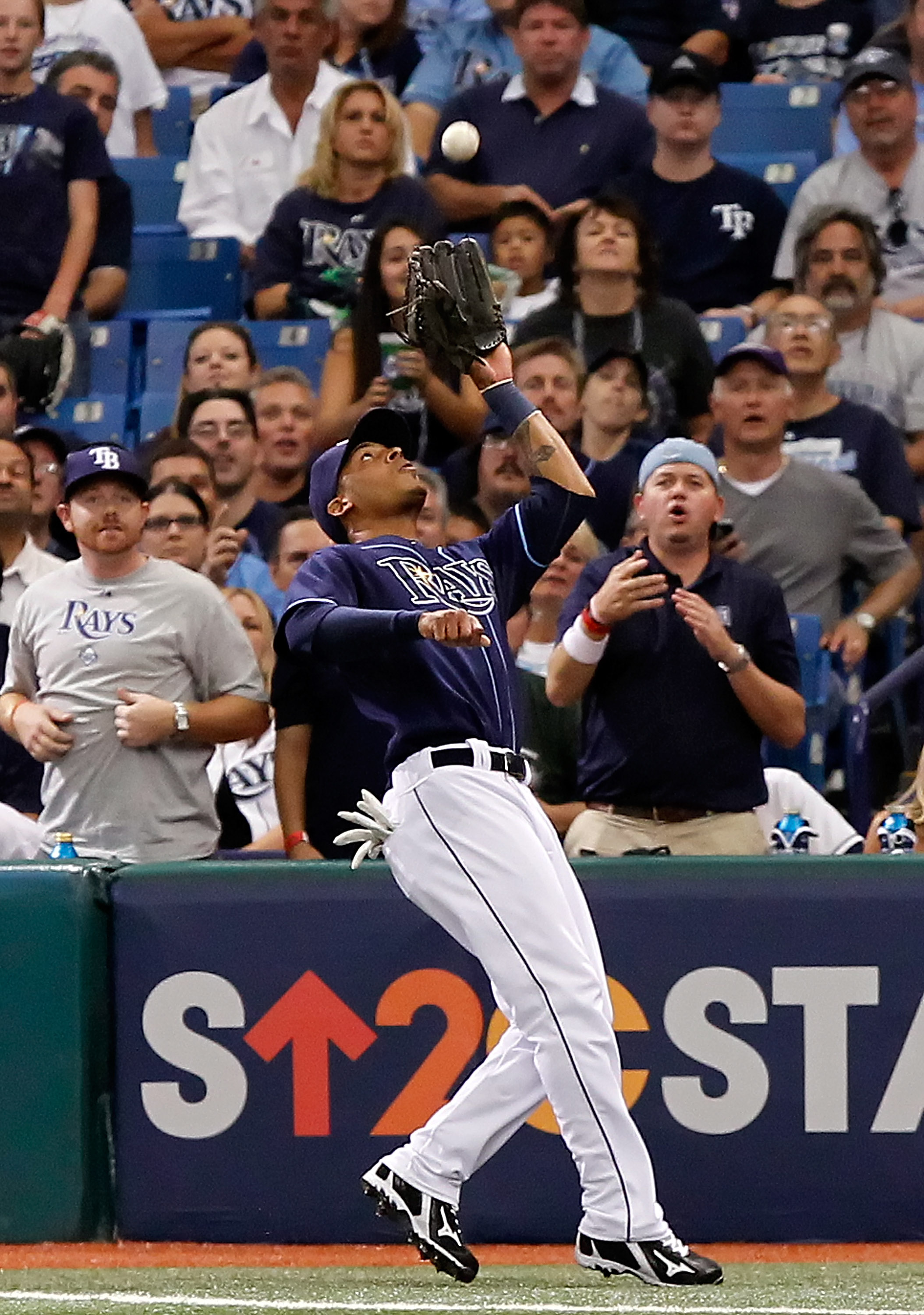 ST. PETERSBURG - OCTOBER 07:  Outfielder Desmond Jennings #27 of the Tampa Bay Rays catches a foul ball against the Texas Rangers during Game 2 of the ALDS at Tropicana Field on October 7, 2010 in St. Petersburg, Florida.  (Photo by J. Meric/Getty Images)
