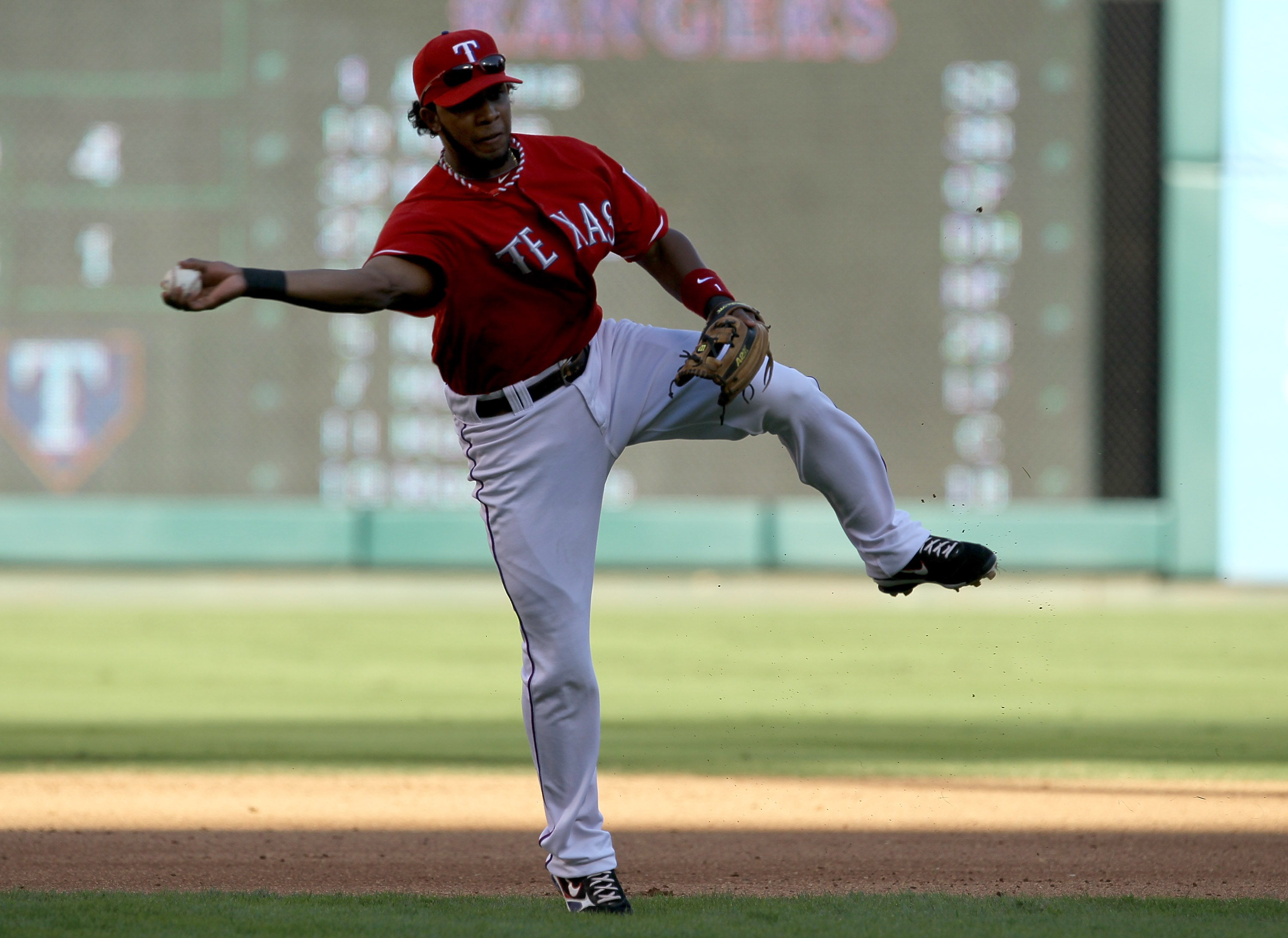 ARLINGTON, TX - OCTOBER 9:   Shortstop Elvis Andrus #1 of the Texas Rangers throws out Evan Longoria of the Tampa Bay Rays in the fourth inning during game three of the ALDS at Rangers Ballpark in Arlington on October 9, 2010 in Arlington, Texas.  (Photo