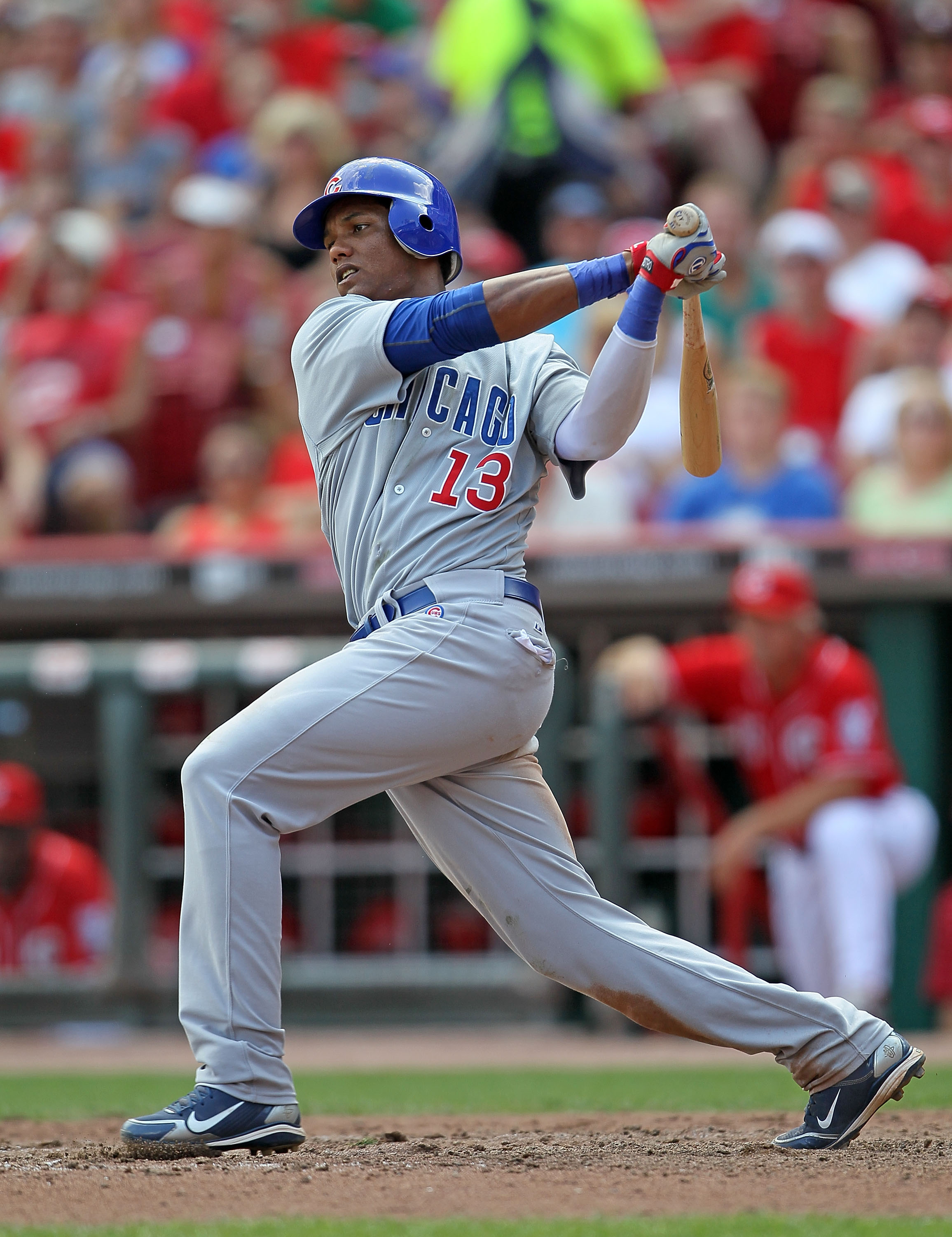 CINCINNATI - AUGUST 29:  Starlin Castro #13 of the Chicago Cubs swings at a pitch during the game against the Cincinnati Reds at Great American Ball Park on August 29, 2010 in Cincinnati, Ohio.  (Photo by Andy Lyons/Getty Images)