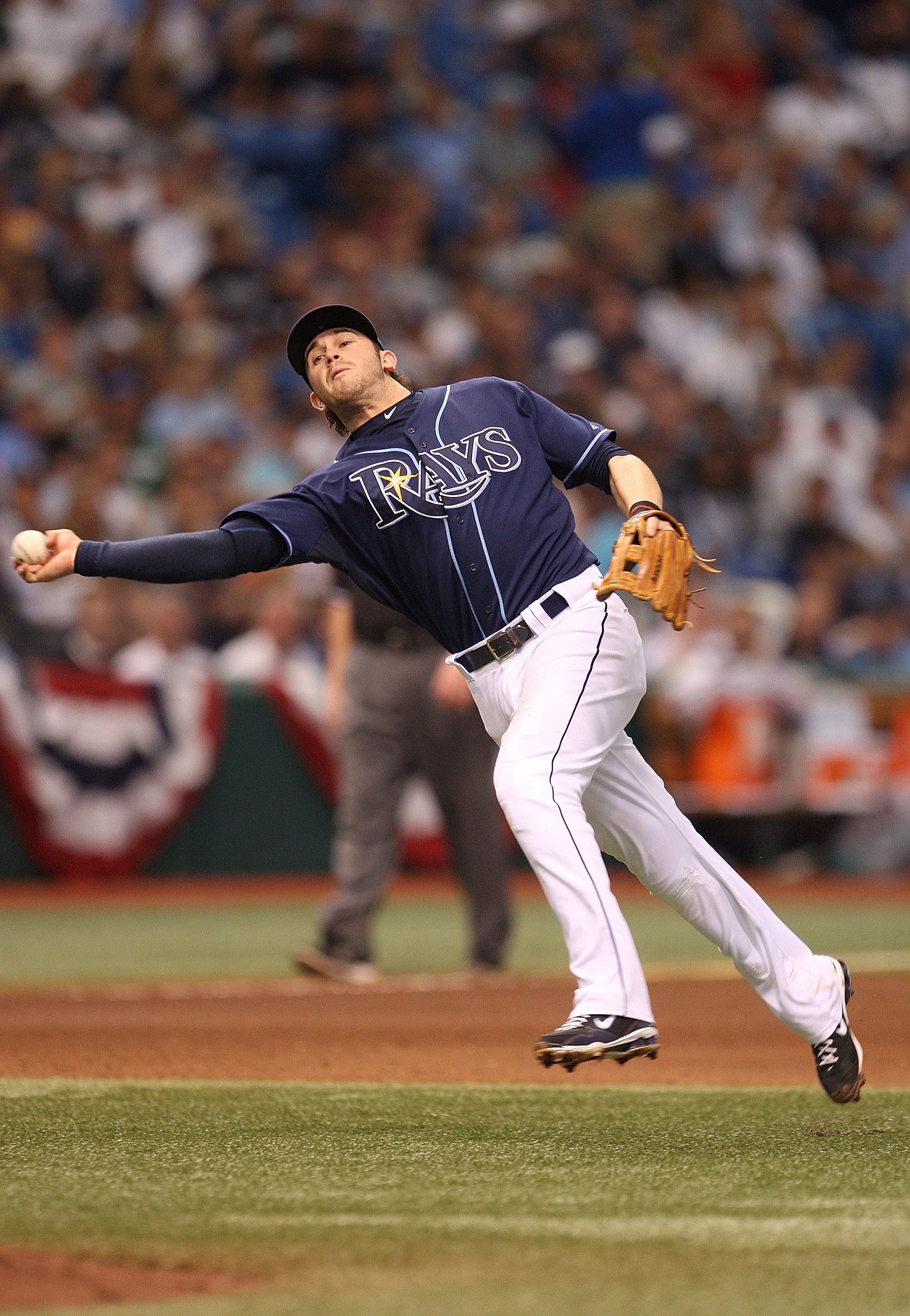 ST PETERSBURG, FL - OCTOBER 07: Evan Longoria #3 of the Tampa Bay Rays makes a throw to first during Game 2 of the ALDS against the Texas Rangers at Tropicana Field on October 7, 2010 in St. Petersburg, Florida.  (Photo by Mike Ehrmann/Getty Images)